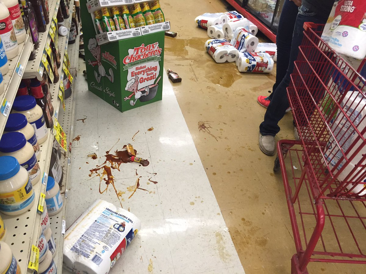 Grocery items fall from the shelves and break  at White's Foodliner after the Saturday morning temblor.  (Bill Schammert/KOKH)