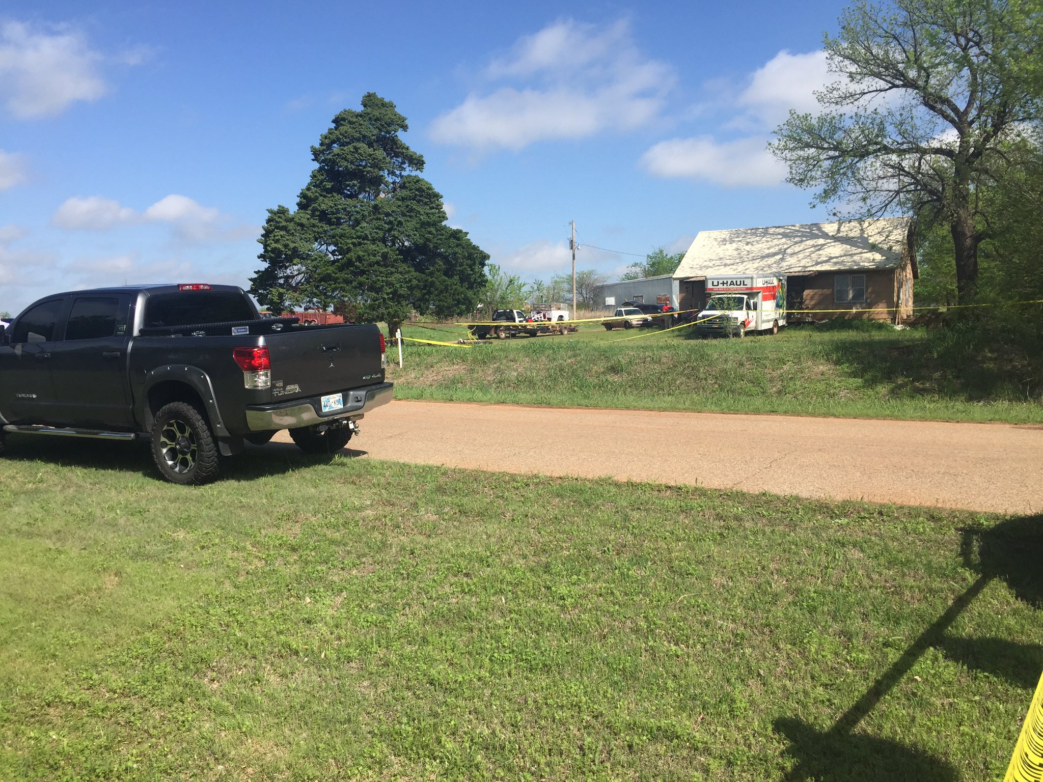 Authorities investigate the scene near Mulhall where a Logan County Sheriff's deputy was shot. (KOKH/Julie Calhoun)