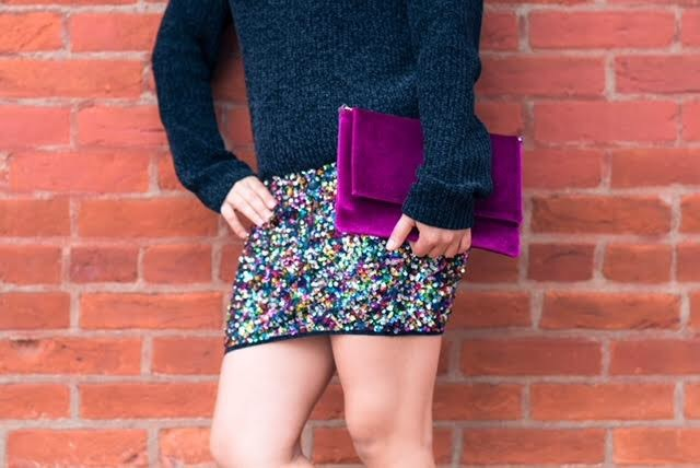 Take full advantage of the holiday and wear this multi-colored sequin skirt ($67.25) /bootie ($72.00) combo. I'd pair it with a plain black top and simple black blazer for an easy, chic ensemble. (Image: Courtesy Violet Boutique)<p></p>