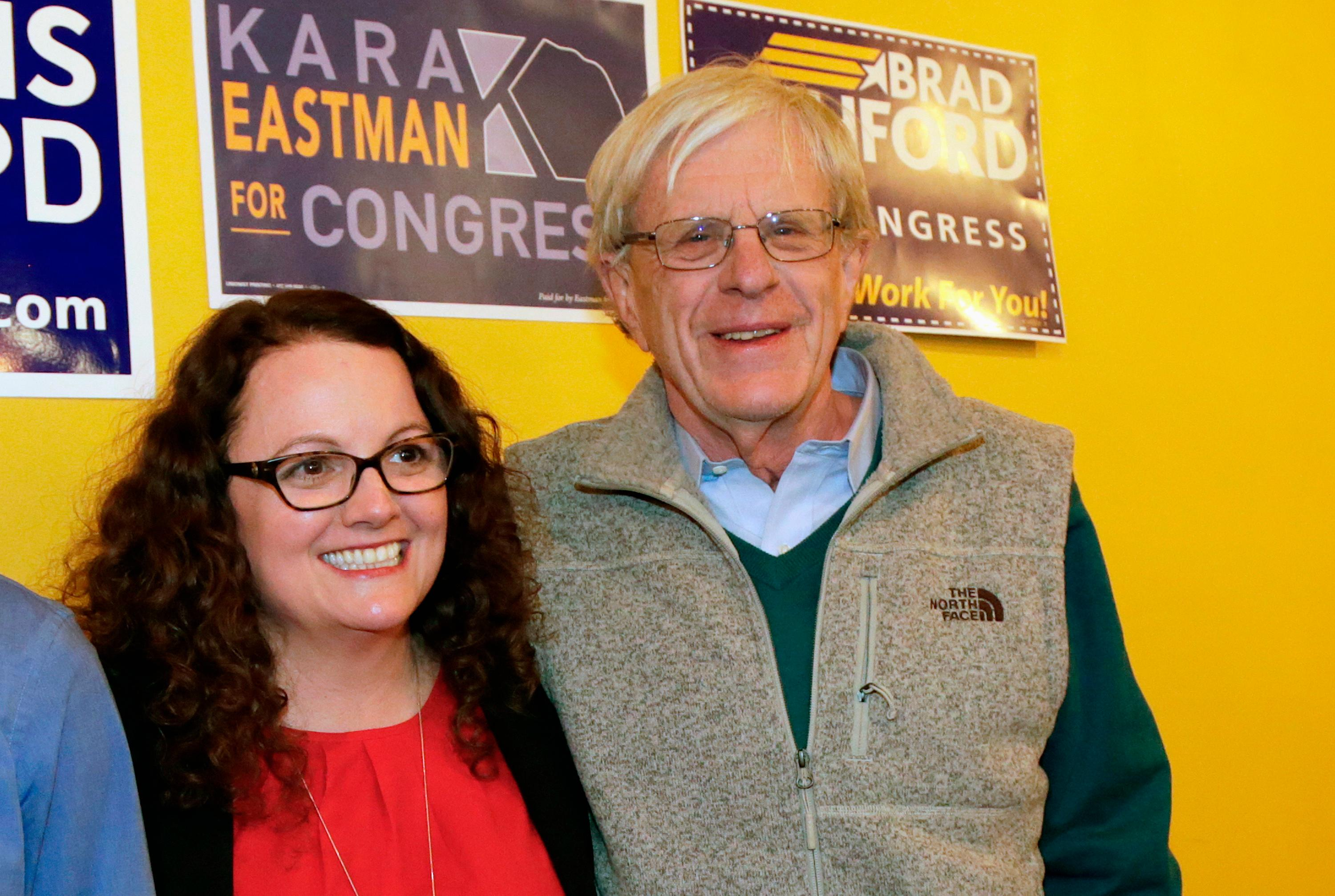 FILE - In this April 5, 2018, photo, Kara Eastman and Brad Ashford, two Democrats vying to challenge 2nd District House incumbent Don Bacon, R-Neb., pose for a photo in Omaha, Neb. Democratic and independent voters will pick one as the party's nominee in the Tuesday, May 15, primary election. (AP Photo/Nati Harnik, File)