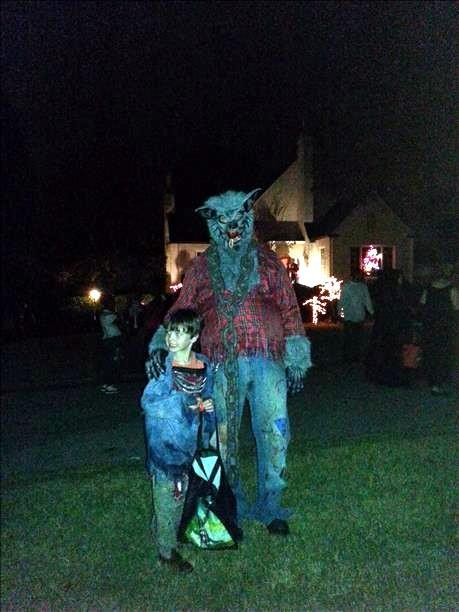 A werewolf and his assistant out for some candy!
