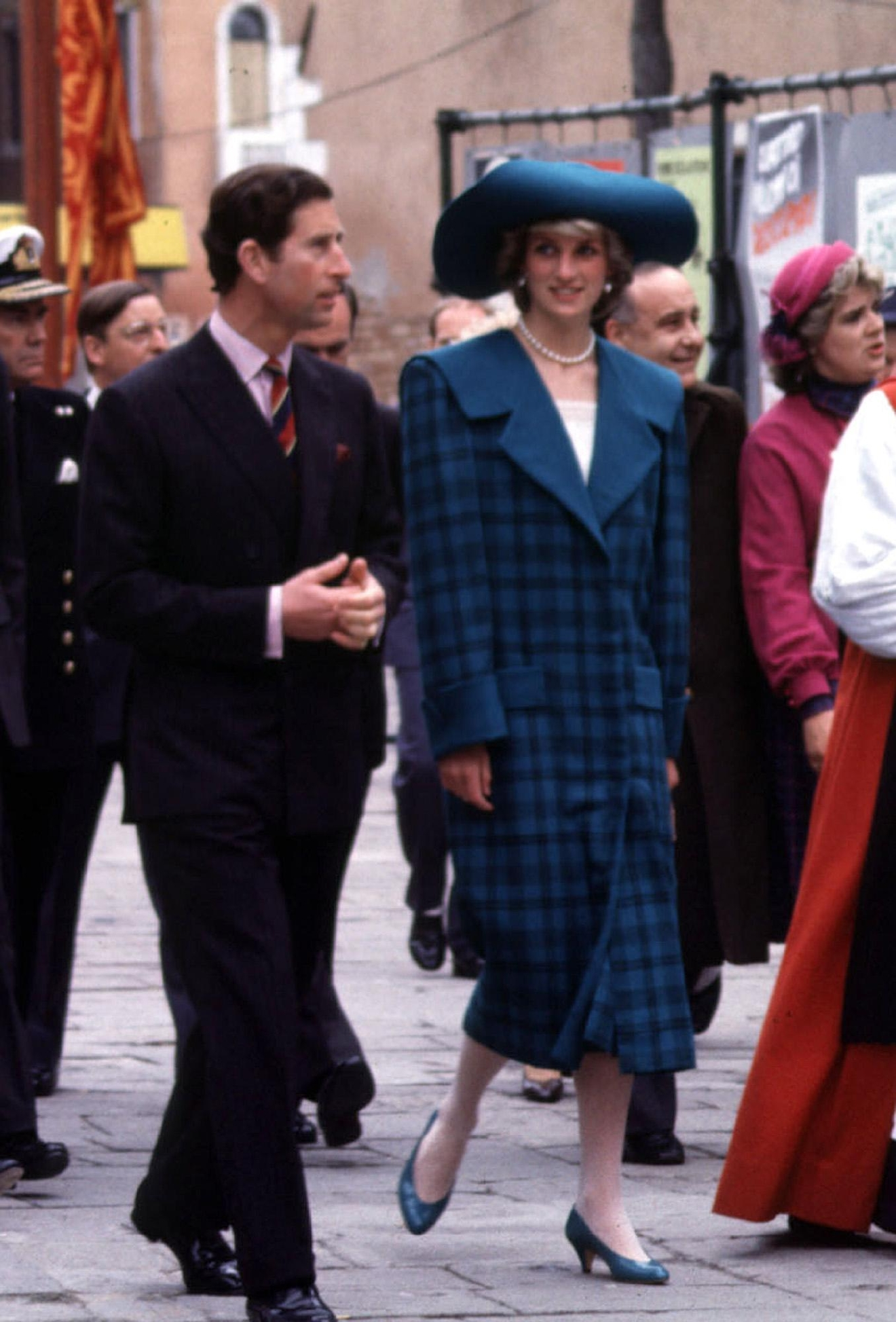 "FILE - In this May 5, 1985 file photo, Diana, Princess of Wales wears a blue tartan Emanuel suit during an official visit to Venice, Italy, with Britain's Prince Chalres. This outfit is featured in an exhibition of 25 dresses and outfits worn by Diana entitled ""Diana: Her Fashion Story"" at Kensington Palace in London, opening on Friday, Feb. 24, 2017.(/PA via AP)"