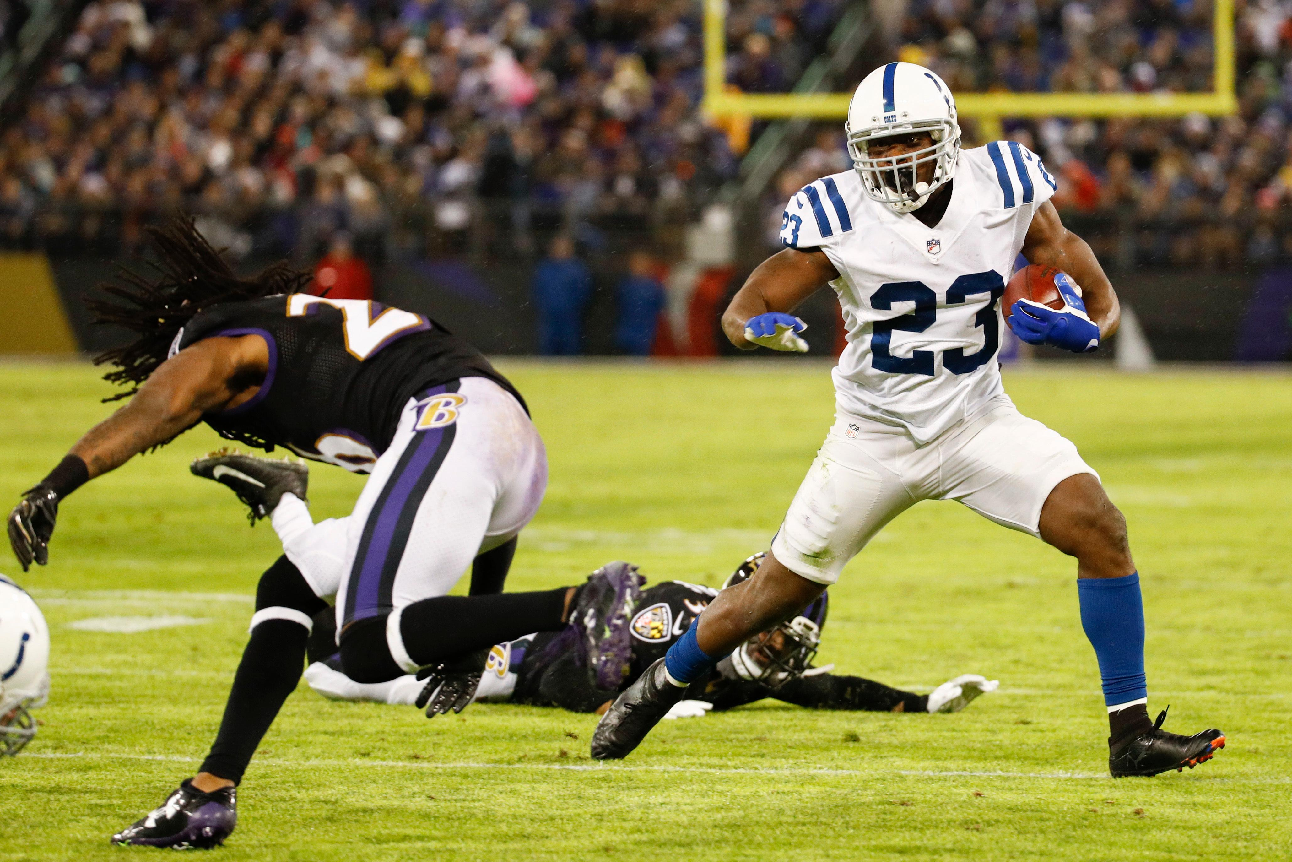 Indianapolis Colts running back Frank Gore (23) runs for a touchdown during the first half of an NFL football game against Baltimore Ravens in Baltimore, Saturday, Dec 23, 2017. (AP Photo/Patrick Semansky)