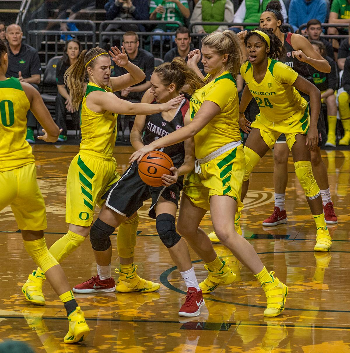 Oregon Ducks Sabrina Ionescu (#20, left) and Mallory McGwire (#44) trap Stanford Cardinal Alanna Smith (#11). The Stanford Cardinal defeated the Oregon Ducks 78-65 on Sunday afternoon at Matthew Knight Arena. Stanford is now 10-2 in conference play and with this loss the Ducks drop to 10-2. Leading the Stanford Cardinal was Brittany McPhee with 33 points, Alanna Smith with 14 points, and Kiana Williams with 14 points. For the Ducks Sabrina Ionescu led with 22 points, Ruthy Hebard added 16 points, and Satou Sabally put in 14 points. Photo by Dan Morrison, Oregon News Lab