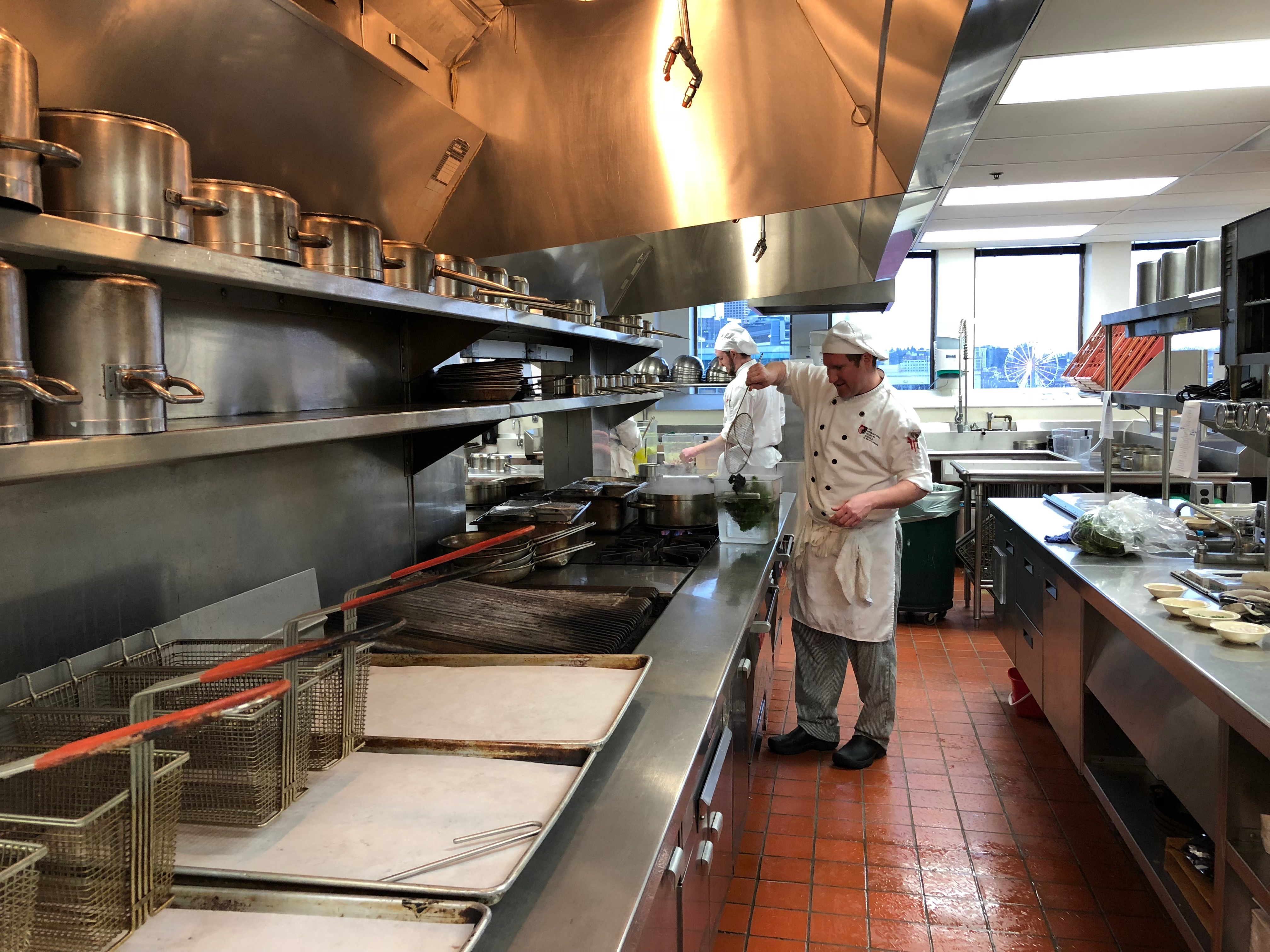 A culinary student working in the kitchen at the Art Institute of Seattle's Portfolio Restaurant. (Seattle Refined)<p></p>