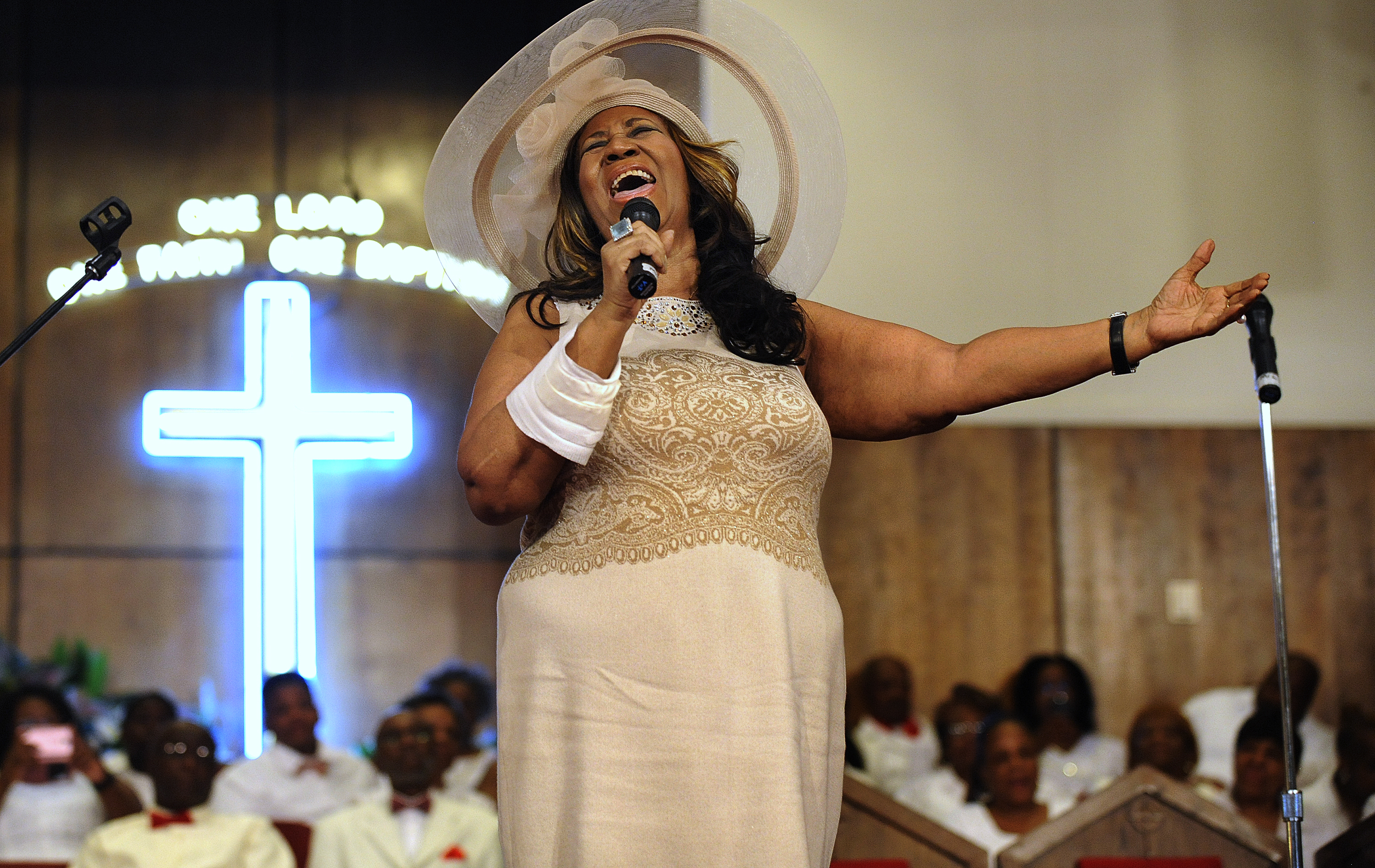 FILE - In this June 7, 2015 file photo, Aretha Franklin sings during a memorial service for her father and brother, Rev. C.L. and Rev. Cecil Franklin, at New Bethel Baptist Church where they were ministers, in Detroit, Mich. Franklin died Thursday, Aug. 16, 2018 at her home in Detroit.  She was 76. (Elizabeth Conley/The Detroit News via AP, File)