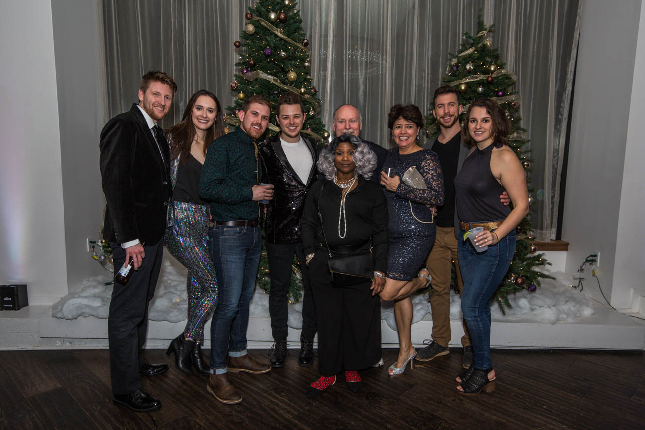 "Chris & Christina Mason, Mark Huelskamp, Brandyn Shepherd, Rochelle Triplett, Sarah Henderson, Kevin Hanington, and Ben & Darien Mogni posed for a group pic at Hotel Covington's ""All That Glitters"" party on December 31. / Image: Catherine Viox // Published: 1.3.19"