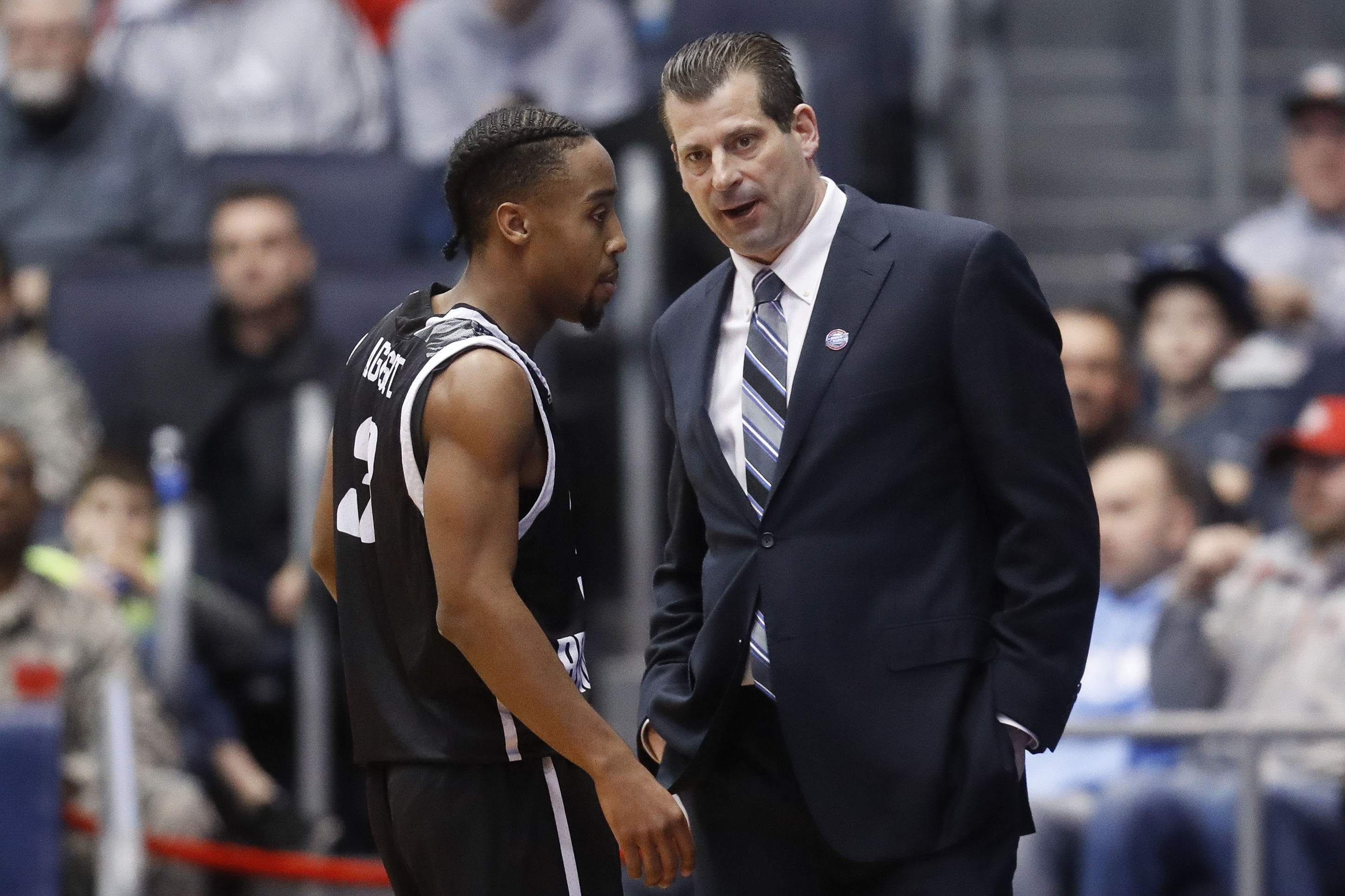LIU Brooklyn head coach Jack Perri, right, speaks with Jashaun Agosto during the first half of a First Four game of the NCAA men's college basketball tournament against Radford, Tuesday, March 13, 2018, in Dayton, Ohio. (AP Photo/John Minchillo)