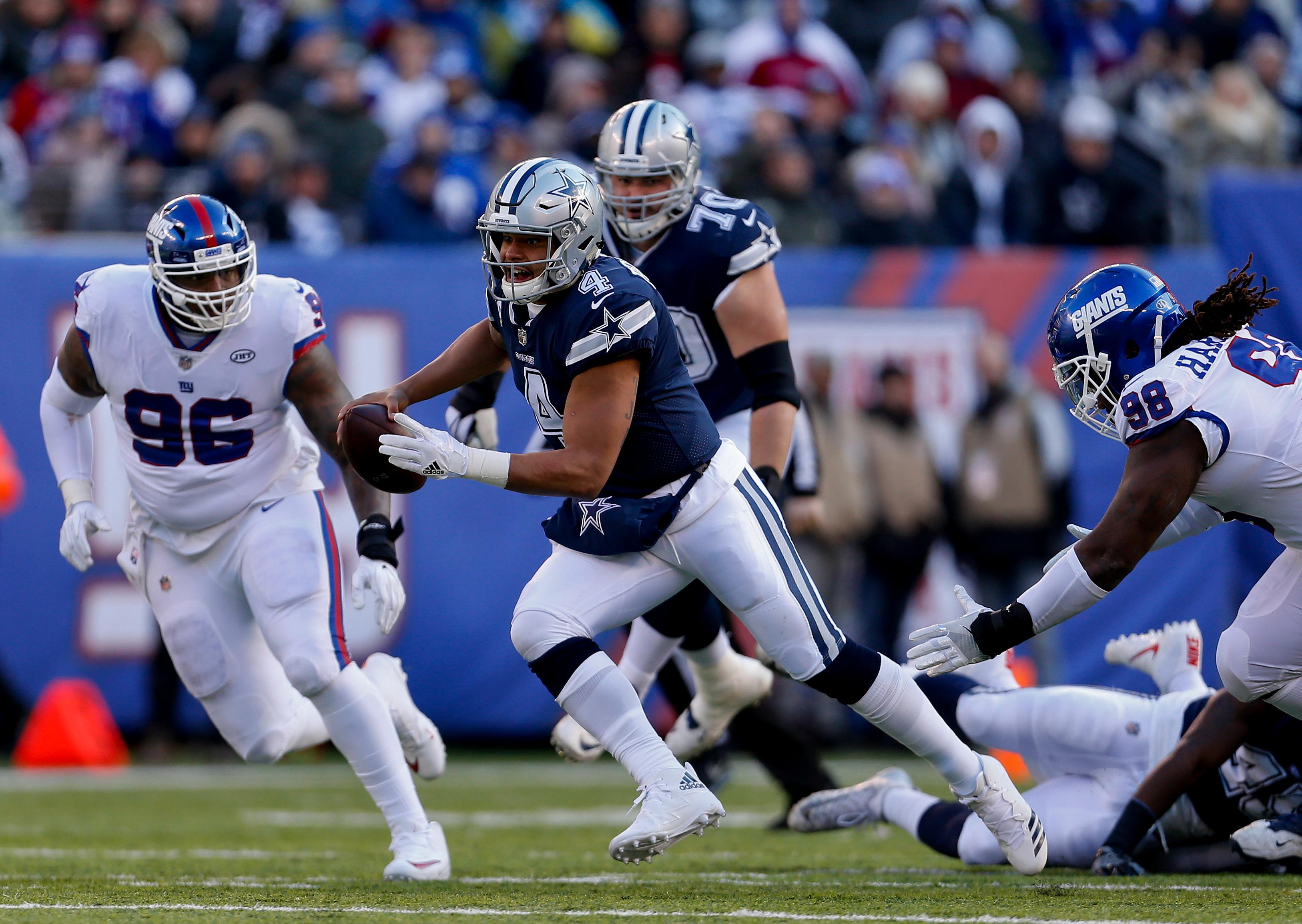 Dallas Cowboys quarterback Dak Prescott (4) runs the ball against the New York Giants during the second quarter of an NFL football game, Sunday, Dec. 10, 2017, in East Rutherford, N.J. (AP Photo/Adam Hunger)