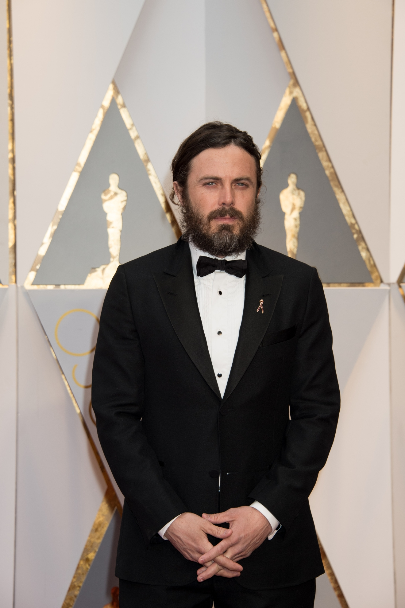 #28: Casey Affleck. It's not his fault. It's hard to accessorize with that beard (it's for a role, btw). (Image: AMPAS)