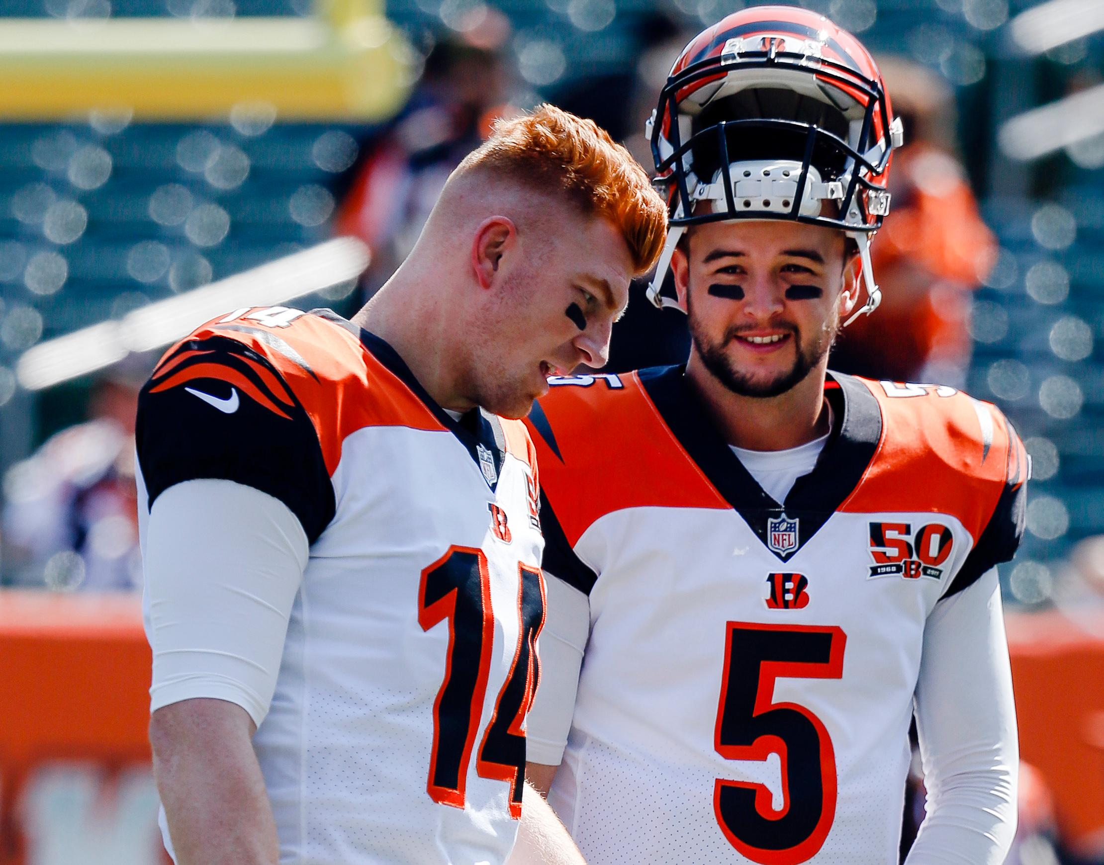 FILE - In this Sept. 10, 2017, file photo, Cincinnati Bengals quarterbacks AJ McCarron (5) and Andy Dalton (14) talk before an NFL football game against the Baltimore Ravens in Cincinnati. McCarron still doesn't know what to make of a botched trade that would have sent the Bengals backup quarterback to Cleveland. The deal was reached, but all the paperwork wasn't submitted to the league before the trade deadline. (AP Photo/Frank Victores, File)