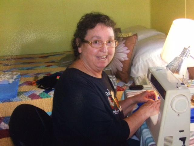 Suzie Higgins' favorite accessory is her sewing machine. She's our Pay it Forward recipient this week. (Image: WTVC)