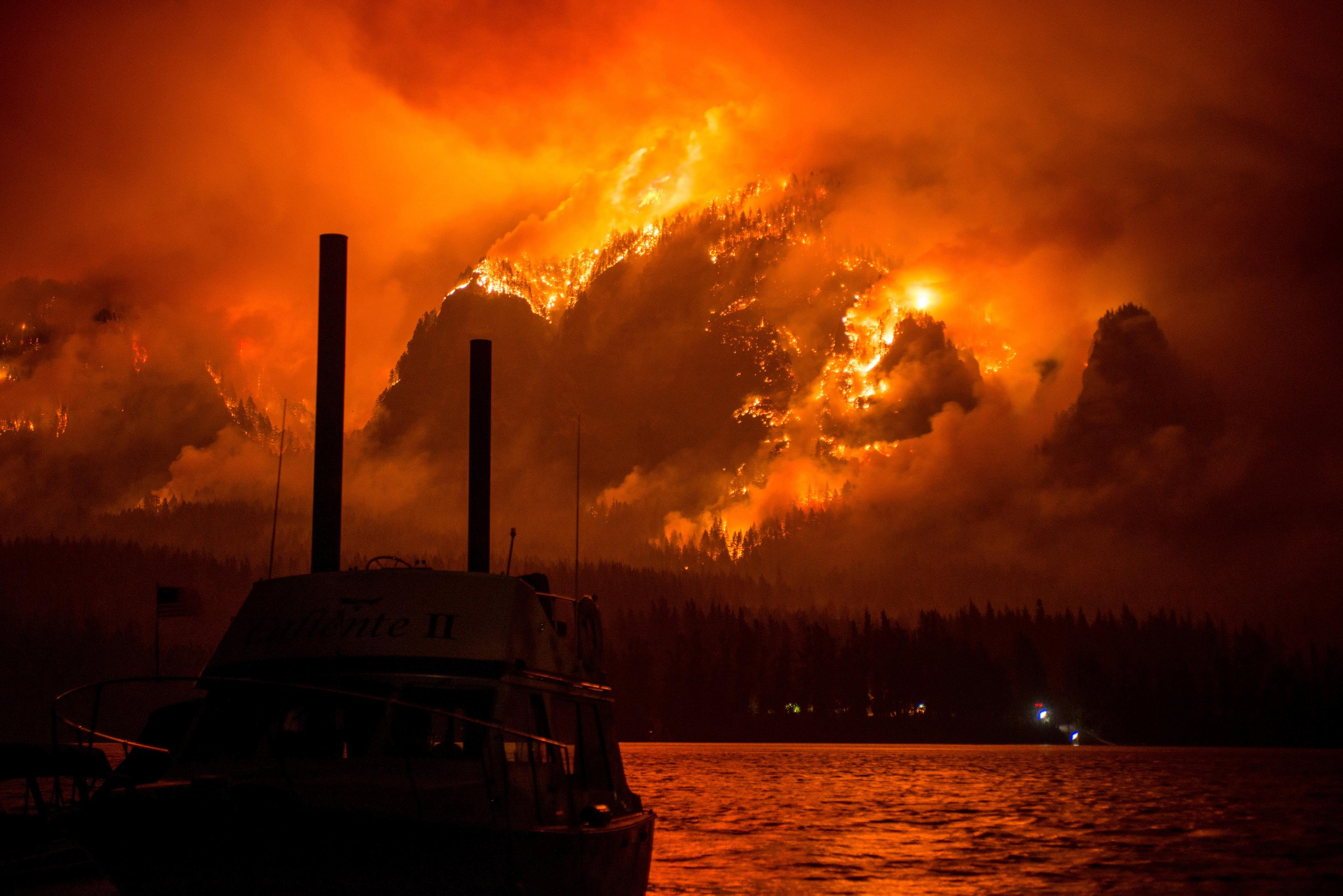This Monday Sept. 4, 2017, photo provided by KATU-TV shows the Eagle Creek wildfire as seen from Stevenson Wash., across the Columbia River, burning in the Columbia River Gorge above Cascade Locks, Ore.