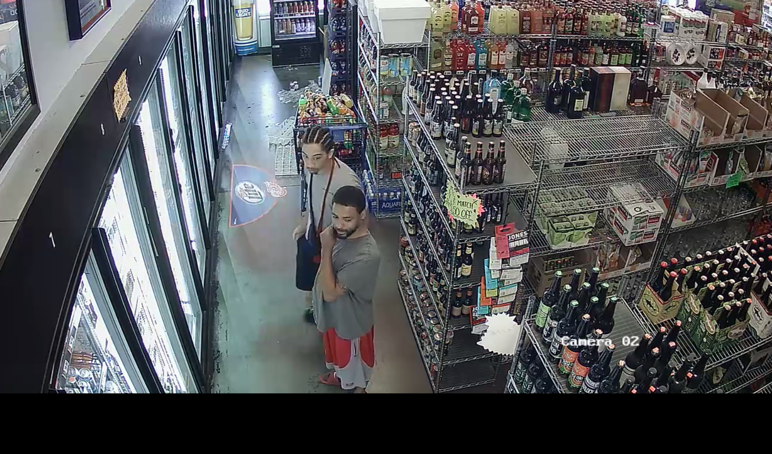 Surveillance photos released after larceny at liquor store (Courtesy: Isabella County Sheriff's Office)