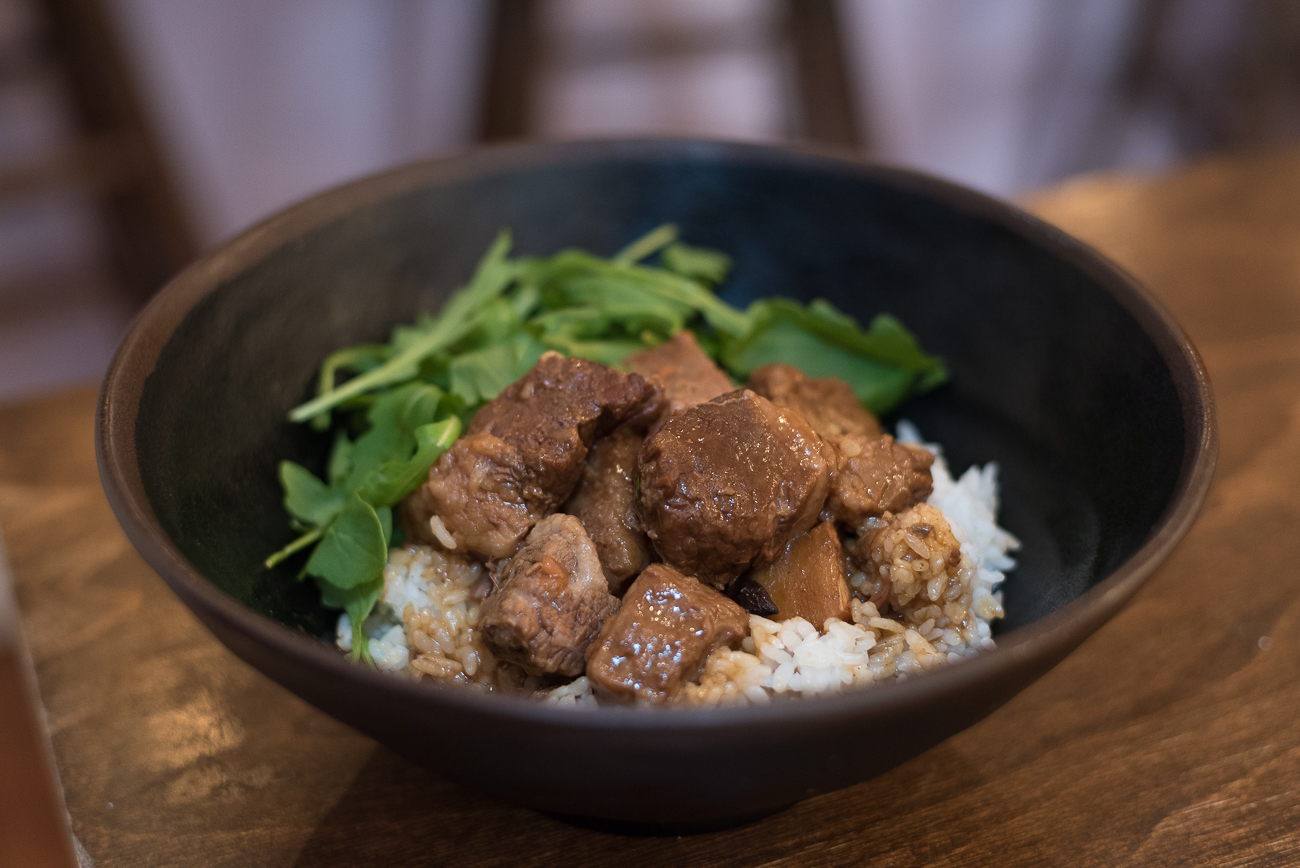 Drunk Brisket Rice Bowl: Drunken brisket with arugula, red caramelized onions, and white rice / Image: Phil Armstrong, Cincinnati Refined // Published: 12.18.17