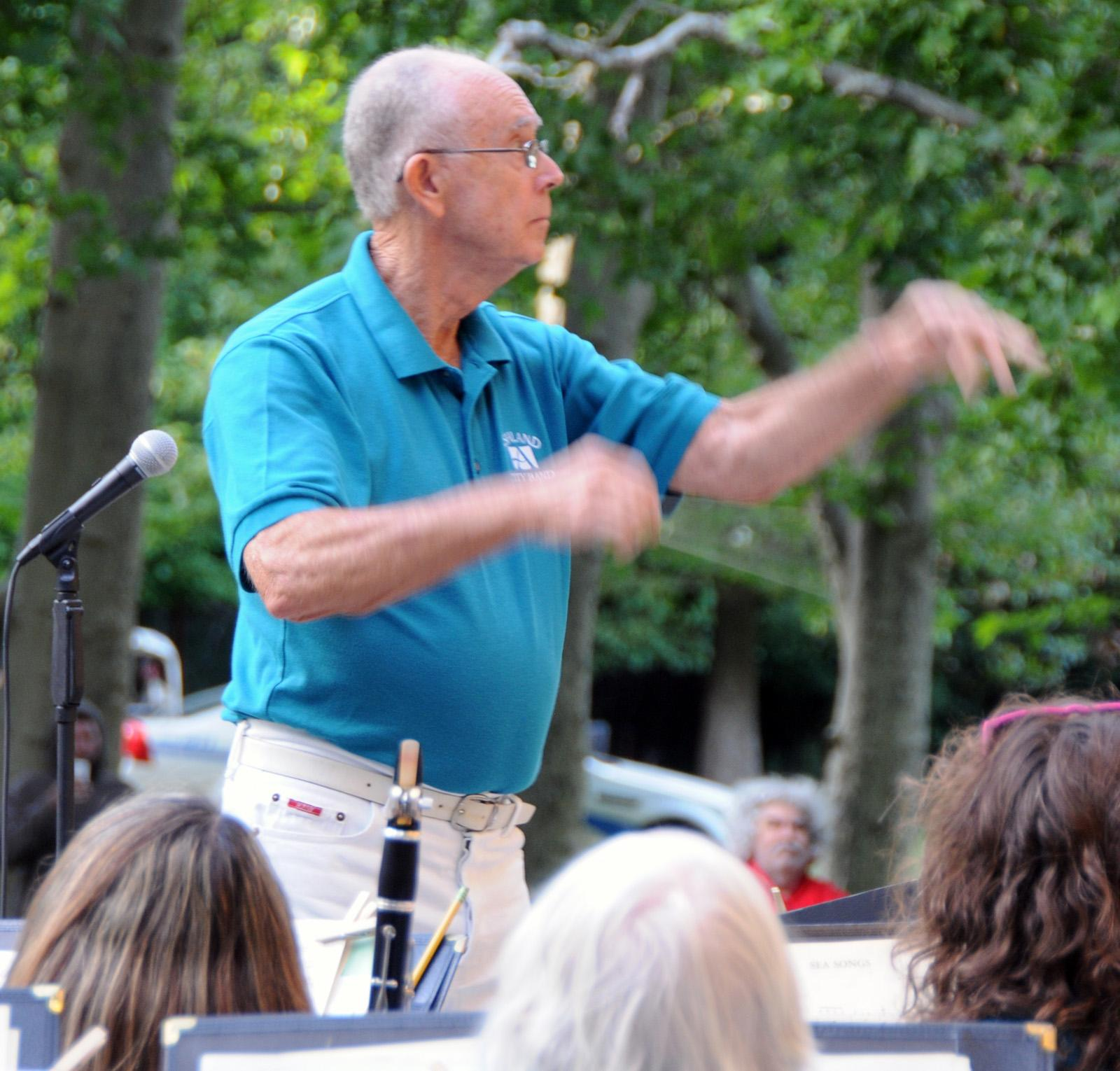 "Director Don Bieghler conducts the band in a medley from ""Man of La Mancha."" (Photo by Jim Flint)"