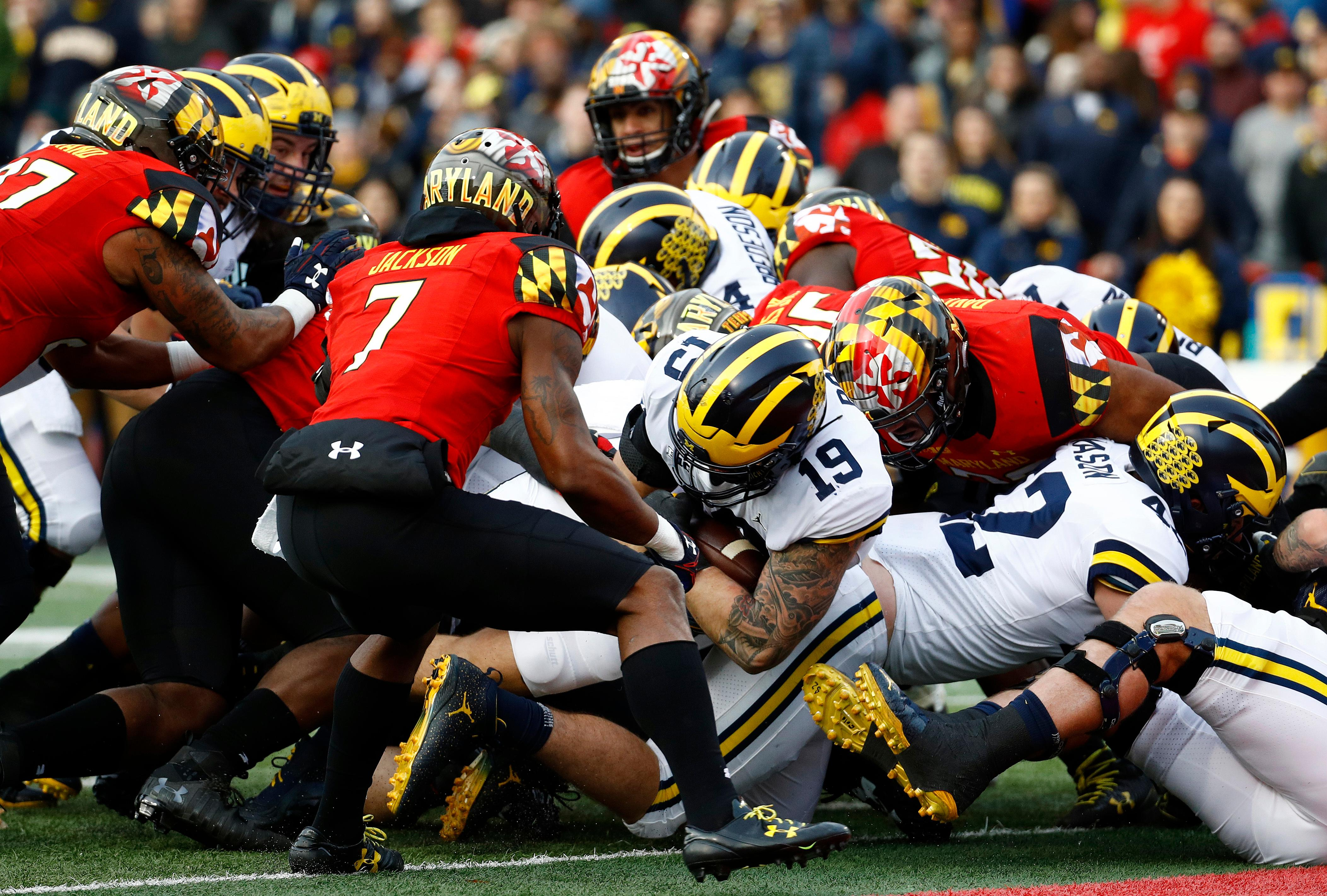Michigan fullback Henry Poggi (19) falls into the end zone for a touchdown in the first half of an NCAA college football game against Maryland in College Park, Md., Saturday, Nov. 11, 2017. (AP Photo/Patrick Semansky)