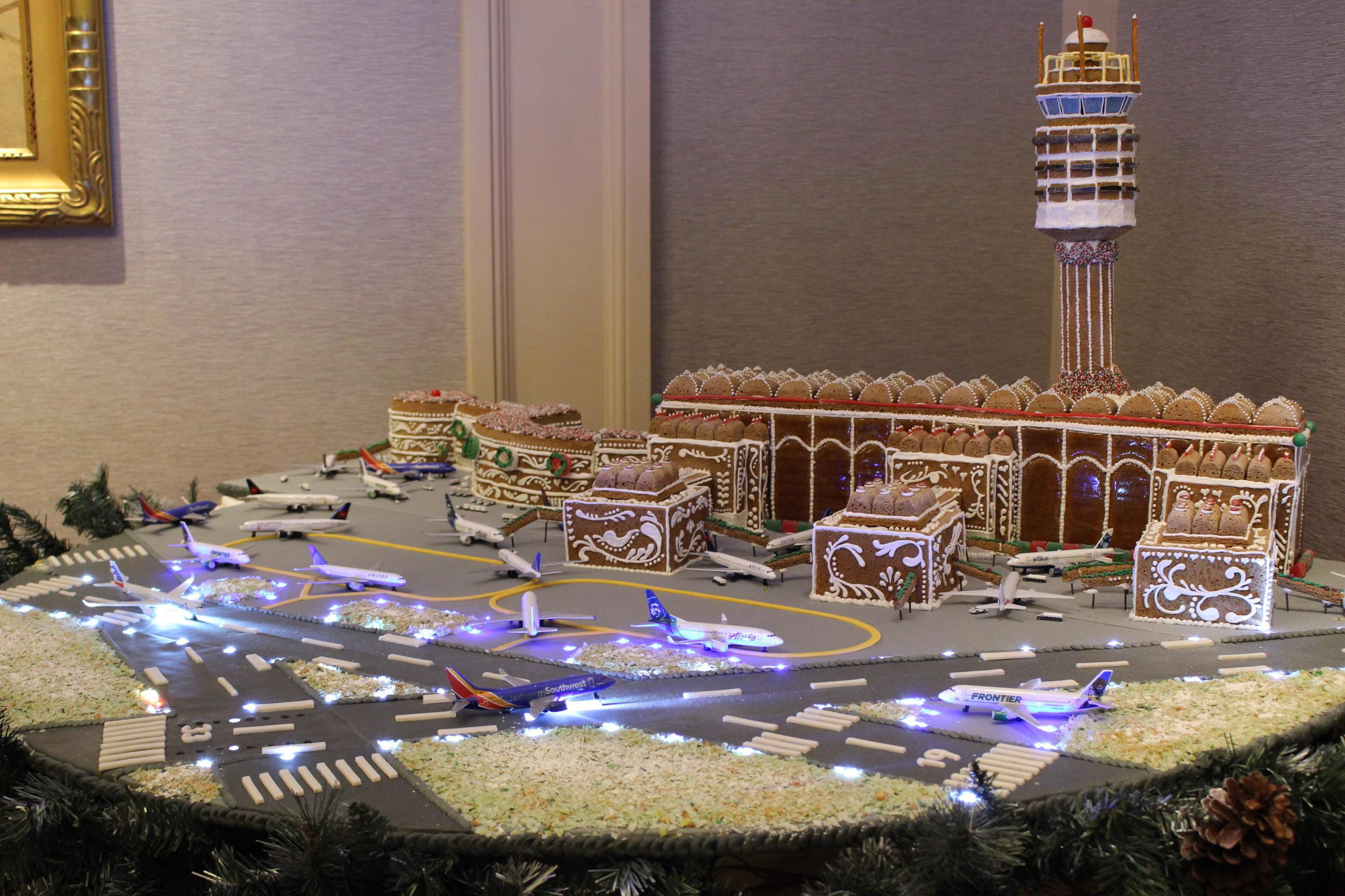The Willard's pastry team unveiled their annual gingerbread display, which pays tribute to a different iconic landmark each year, on November 29. This year, the chosen monument was Ronald Reagan Washington National Airport. All eight airlines that fly into the airport are represented on the display, and Air Force One One hangs above the display as it does a fly-over on its way to Andrews Air Force Base. (Image: Courtesy{ }The Willard InterContinental)