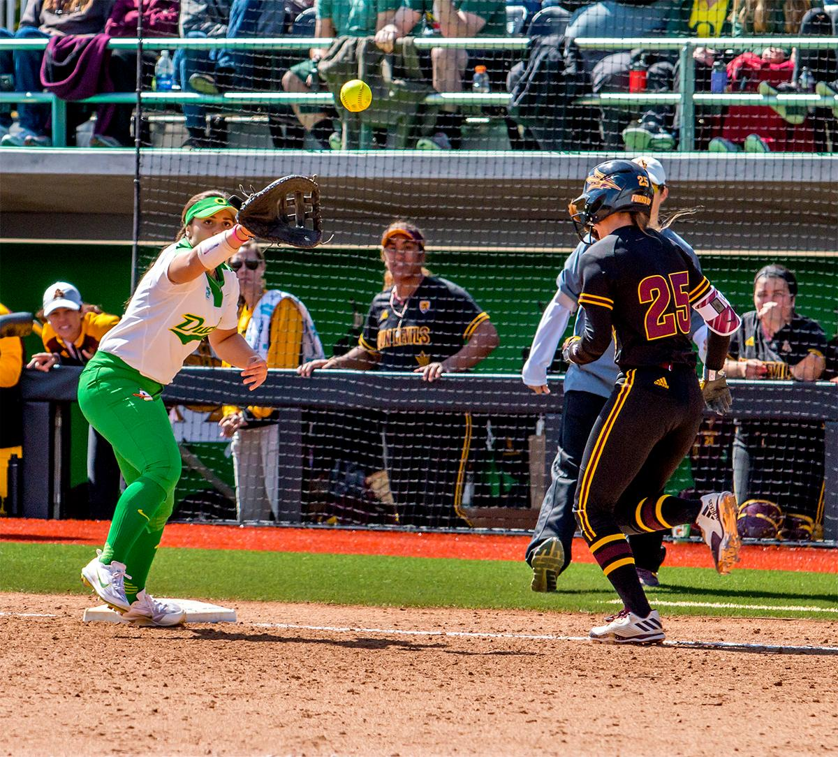 The Duck's Mia Camuso (#7) makes the catch to strike out the Sun Devils' Brianna Wise (#25). The Oregon Ducks Softball team took their third win over the Arizona Sun Devils, 1-0, in the final game of the weekends series that saw the game go into an eighth inning before the Duck?s Mia Camuso (#7) scored a hit allowing teammate Haley Cruse (#26) to run into home plate for a point. The Ducks are now 33-0 this season and will next play a double header against Portland State on Tuesday, April 4 at Jane Sanders Stadium. Photo by August Frank, Oregon News Lab