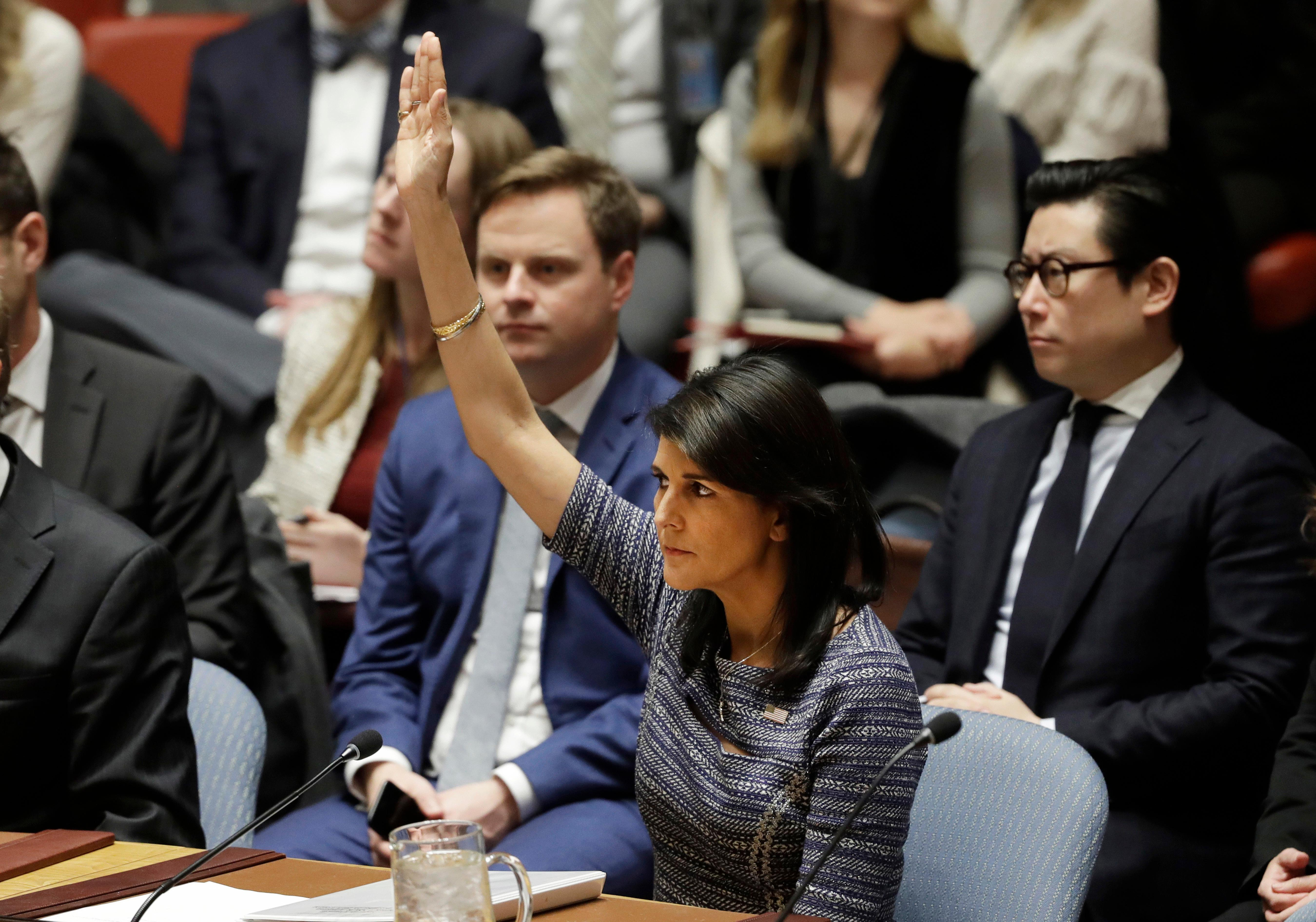 U.S. Ambassador Nikki Haley votes in favor of a resolution, Friday, Dec. 22, 2017, at United Nations headquarters. The Security Council is voting on proposed new sanctions against North Korea, including sharply lower limits on its refined oil imports, the return home of all North Koreans working overseas within 12 months, and a crackdown on the country's shipping. (AP Photo/Mark Lennihan)
