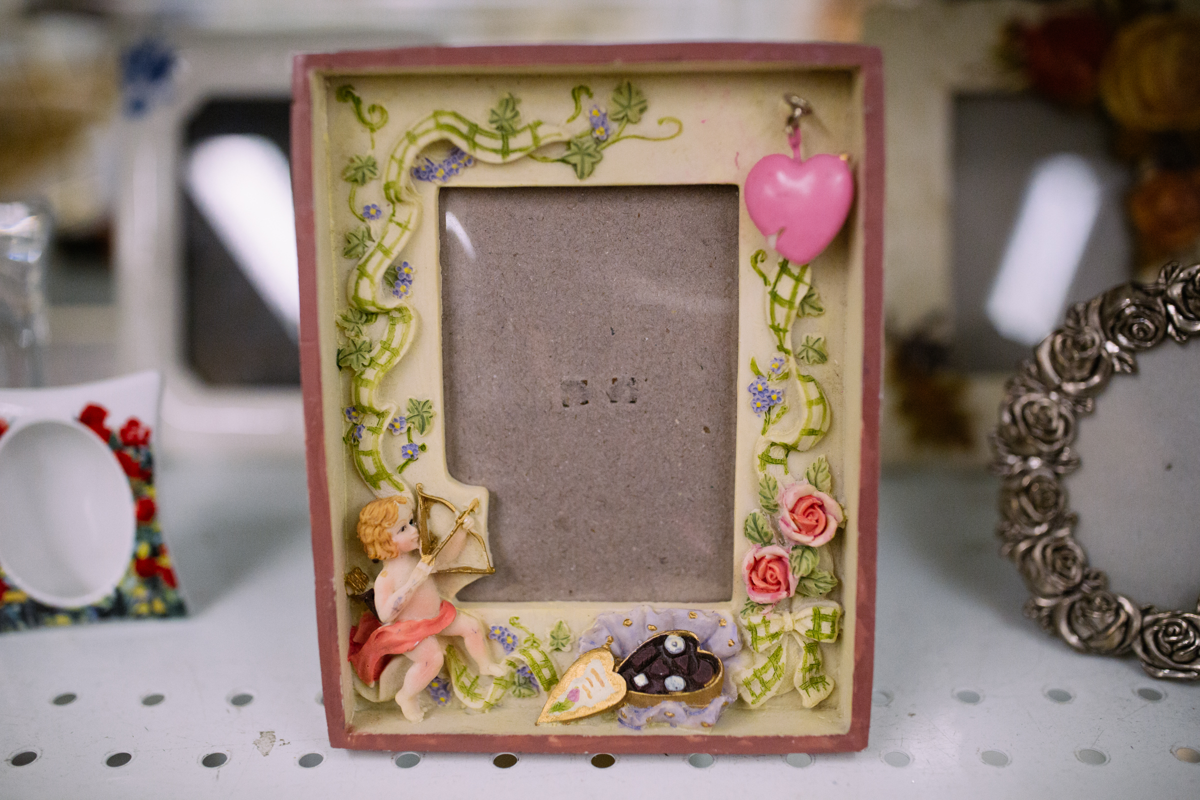 Decorative picture frame. $1.99  Are you going to a White Elephant Gift Exchange this year? We headed to our local Value Village to give you some gift ideas and how much they cost. (Image: Joshua Lewis / Seattle Refined)