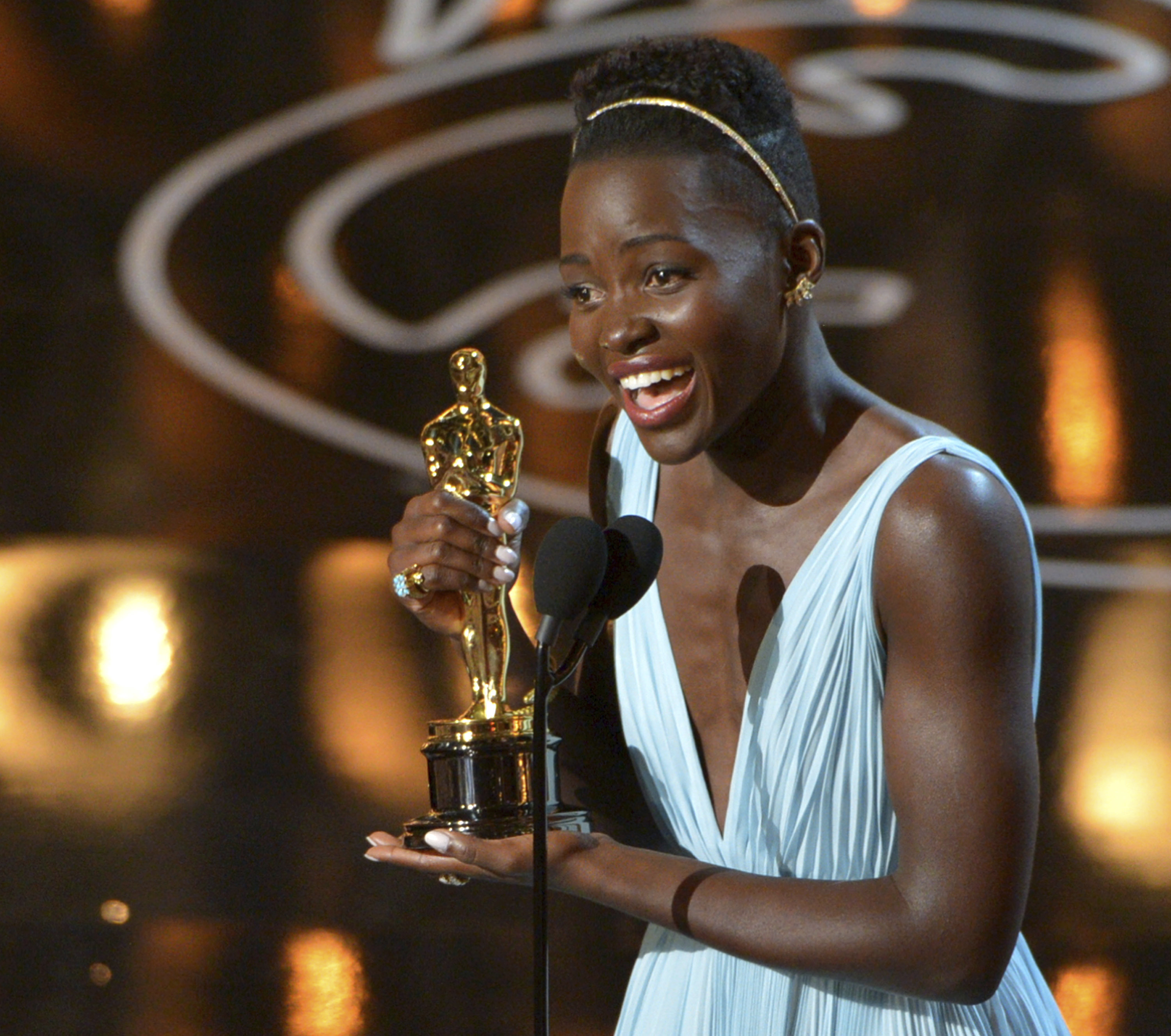 "FILE - In this Sunday, March 2, 2014, file photo, Lupita Nyong'o accepts the award for best actress in a supporting role for ""12 Years a Slave"" during the Oscars at the Dolby Theatre in Los Angeles. (Photo by John Shearer/Invision/AP, File)"