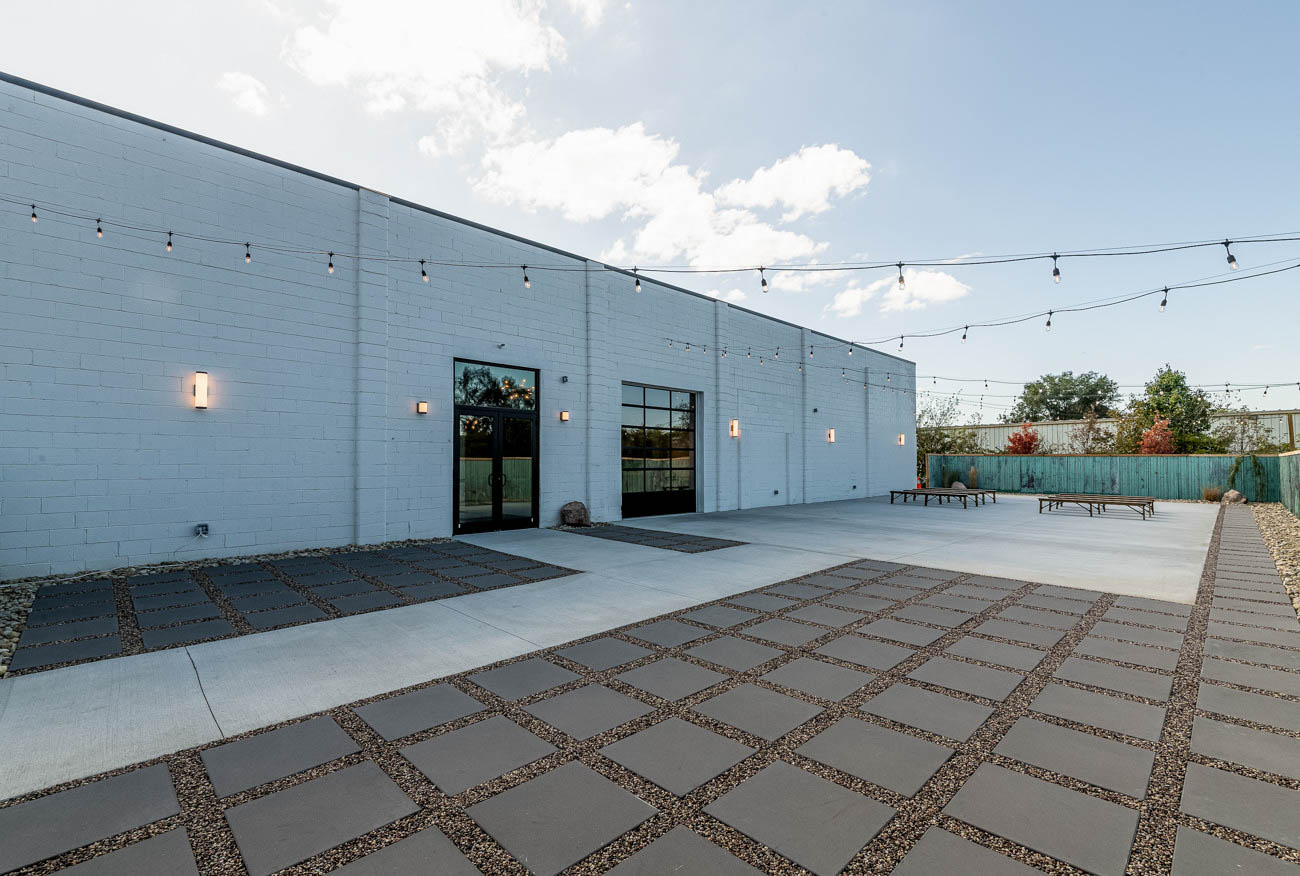 """We knew that having an inviting outdoor space for ceremonies and other events was important, and the large garage door allows both outdoors and indoors to seamlessly flow together. Whether it be a wedding, corporate party, bar mitzvah, charity event; it can be very versatile for any type of event."" -Ben & Christina Elsass / Image: MKF Photo via Mojave East // Published: 10.23.19"