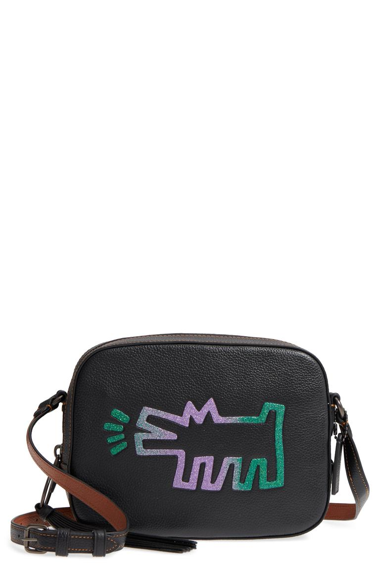 COACh teamed up with American graffiti-pop artist Keith Haring for designer fashion using Haring's recognizable dog-and-UFO graphics floating over prairie florals. The structured crossbody camera bag is functional and fashionable. (Image: Courtesy Nordstrom)