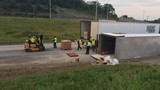 Driver injured after tractor trailer carrying cheese flips over in North Nashville