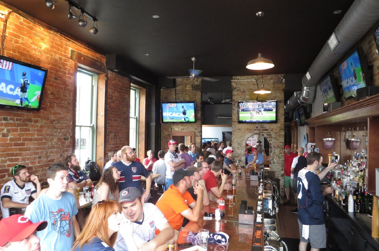 WHERE: Rhinehaus / LOCATION: 119 East 12th Street / DESCRIPTION: This OTR dive is always crowded because it takes a minimalist approach to… everything. It has become known as a soccer hotspot with FCC fans packing it for every match, and Bengals games are packed as well. / Image courtesy of Rhinehaus / Published: 11.8.16every match, and Bengals games are packed as well. / Image courtesy of Rhinehaus / Published: 11.8.16