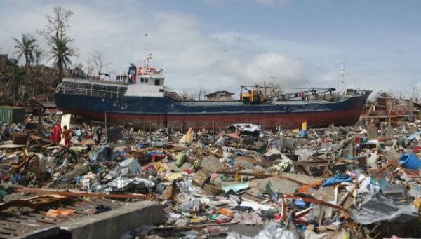A large boat sits aground surrounded by debris in Tacloban on November 10.