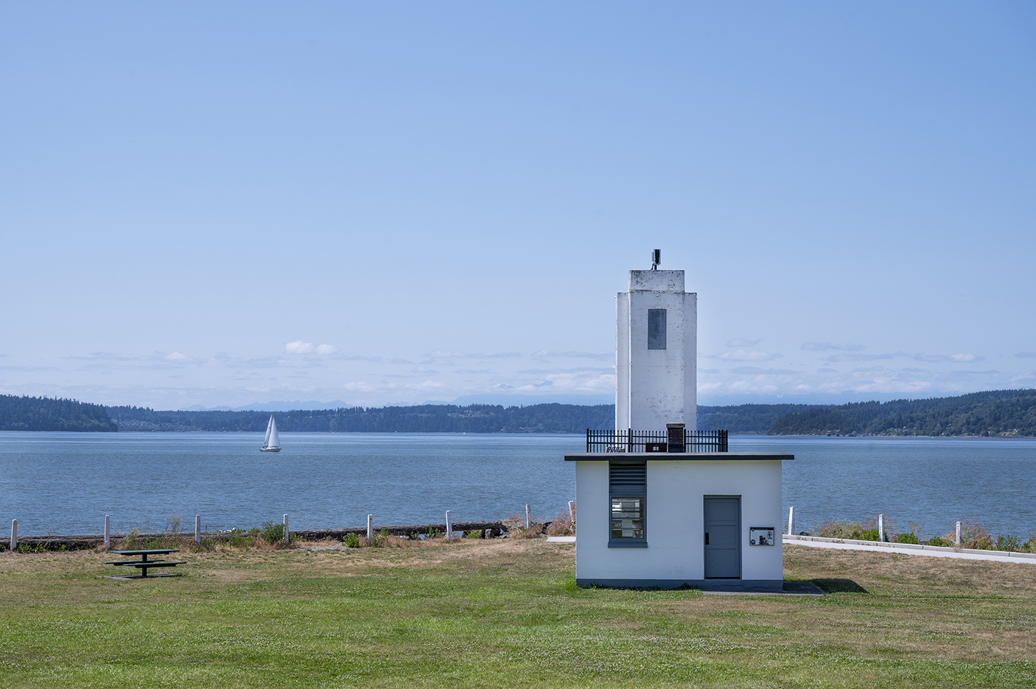 In 1901, the Browns Point lantern post was officially built into a wooden structure lighthouse. Decades later, in 1933, the lighthouse was renovated into a 34 foot tall, concrete masterpiece with all the art deco goodness, and fully automated in 1963. (Image: Rachael Jones / Seattle Refined)