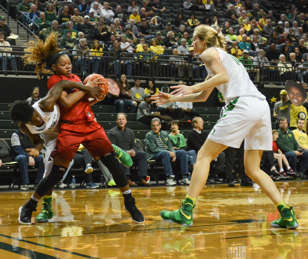 Cardinals Chastadie Barrs and Ducks Mar'Shay Moore fight over a rebound. The Oregon Ducks women's basketball team won their season opener against the Lamar Cardinals 84-67. Photo by Jacob Smith, Oregon News Lab