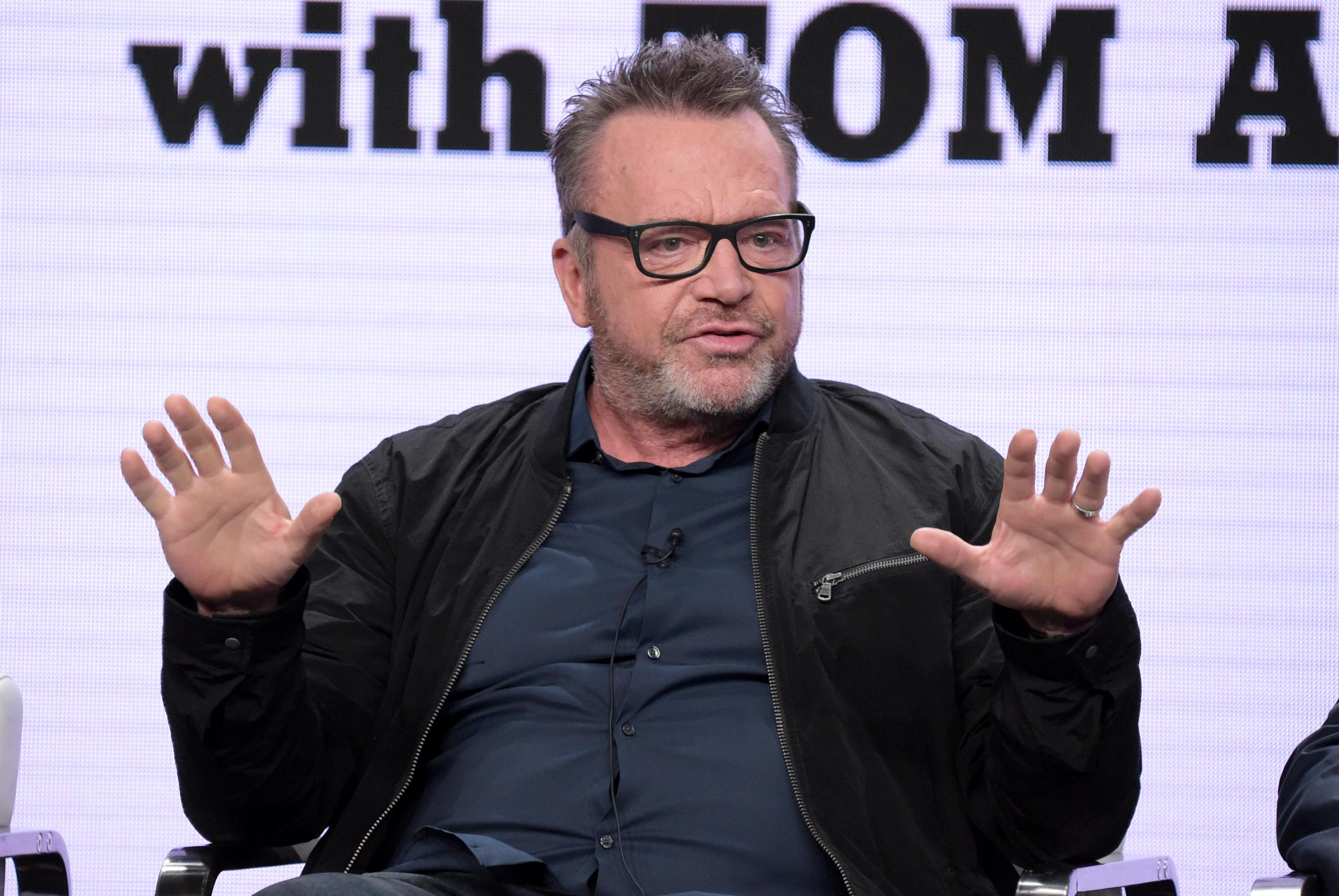 "FILE - In this July 26, 2018, file photo, host and executive producer Tom Arnold participates in Viceland's ""The Hunt for the Trump Tapes with Tom Arnold"" panel. (Photo by Richard Shotwell/Invision/AP, File)"