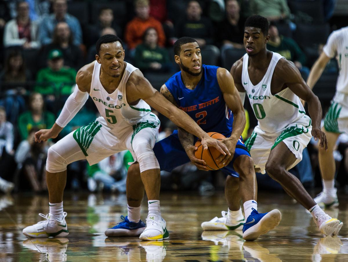 Boise State Bronco Lexus Williams (#2) tries to hold on to the ball while being pressured by University of Oregon Ducks Elijah Brown (#5) and Victor Bailey Jr. (#10). The Boise State Broncos defeated the University of Oregon Ducks 73 – 70 at Matthew Knight Arena in Eugene, Ore., on December 1, 2017. Photo by Kit MacAvoy, Oregon News Lab