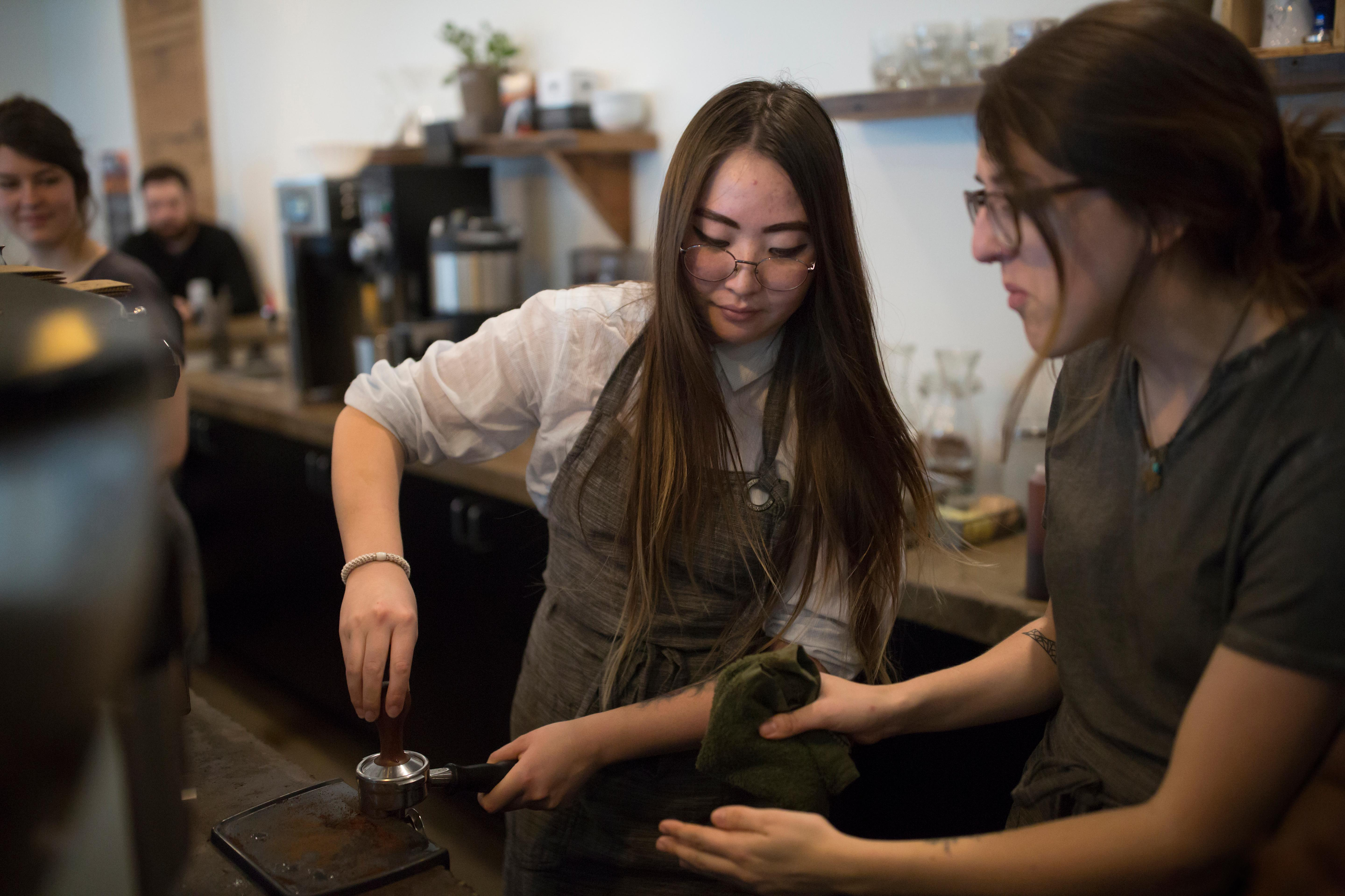 22-year-old Ynga Chernogradskaia at Street Bean Coffee Roasters, a local coffee shop and non-profit that's dedicated to providing work opportunities for street-involved youth. (Sy Bean / Seattle Refined)