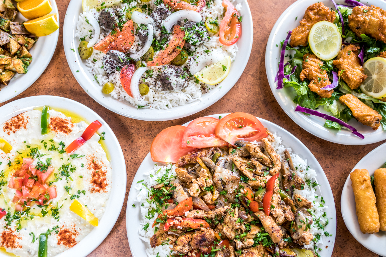 Baba Ghannouj, Spicy Potatoes, Spicy Chicken Wings, Lamb Kofta Platter, and Chicken Shawarma Platter / Image: Catherine Viox // Published: 9.23.20