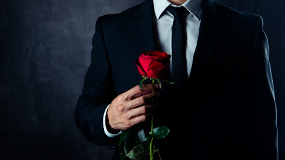 Man holding rose. (Getty Images via Deagreez).jpg