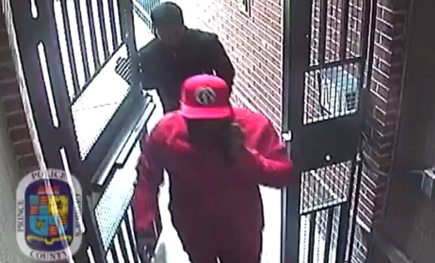 According to police, Moore, who has been arrested, enters first wearing red.  Police are looking for the other two suspects seen in the video. (Photo: Prince George's County police)