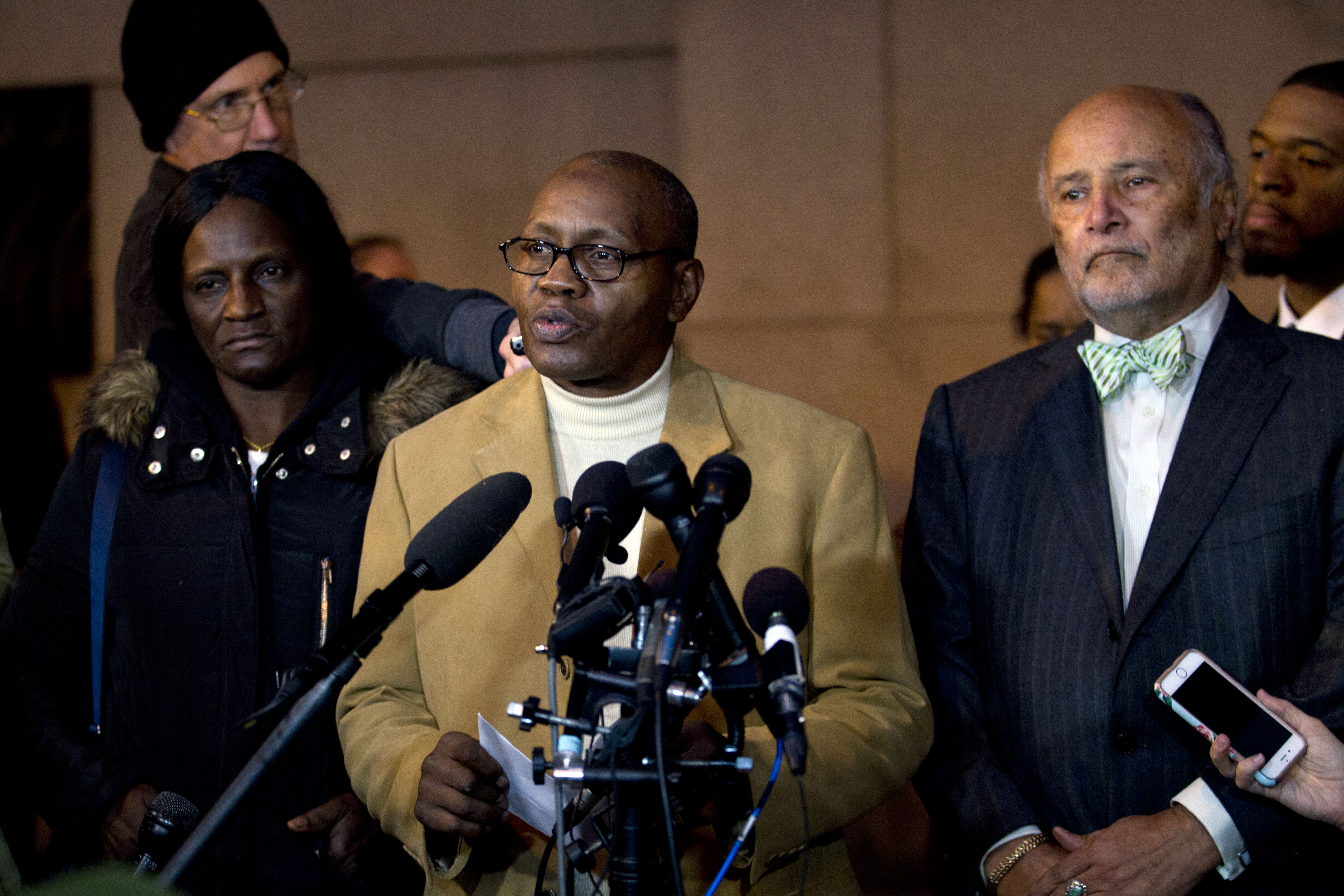 Freddie Gray's stepfather Richard Shipley, center, with Gray's mother Gloria Darden and lawyer Billy Murphy, speaks with the media after a mistrial was declared in the manslaughter trial of Officer William Porter, one of six Baltimore city police officers charged in connection to the death of Freddie Gray on Wednesday, Dec. 16, 2015, in Baltimore Md. (AP Photo/Jose Luis Magana)