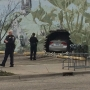 Driver in stolen car crashes into building