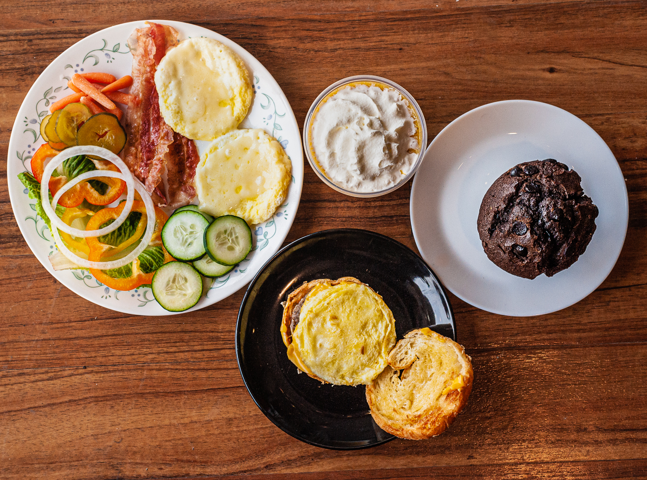 Breakfast Plate, mango smoothie, chocolate muffin, and breakfast sandwich{ }/ Image: Kellie Coleman // Published: 1.31.21