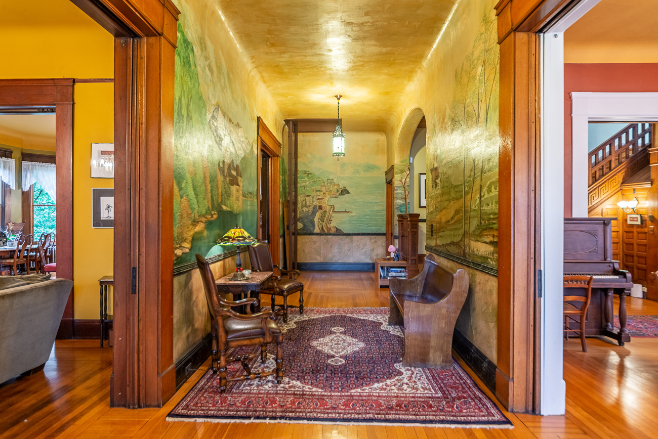The foyer features hand-painted murals that were done sometime in the early 1900s. The track at the end of the hallway is part of a two-story elevator that was installed decades before the Graeters purchased the house. / Image courtesy of Homeshake // Published: 2.28.20