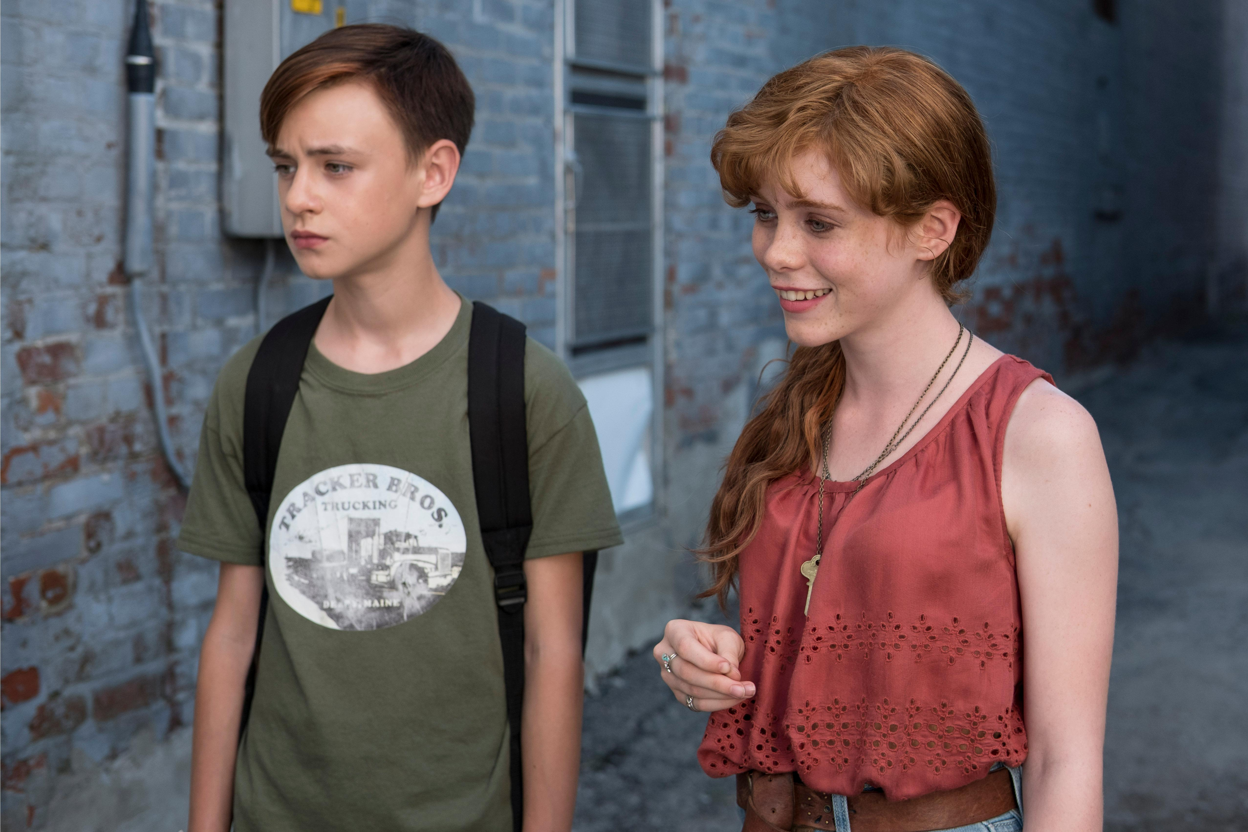 "(L-R) JAEDEN LIEBERHER as Bill Denbrough and SOPHIA LILLIS as Beverly Marsh in New Line Cinema's horror thriller ""IT,"" a Warner Bros. Pictures release. Photo Credit: Brooke Palmer"
