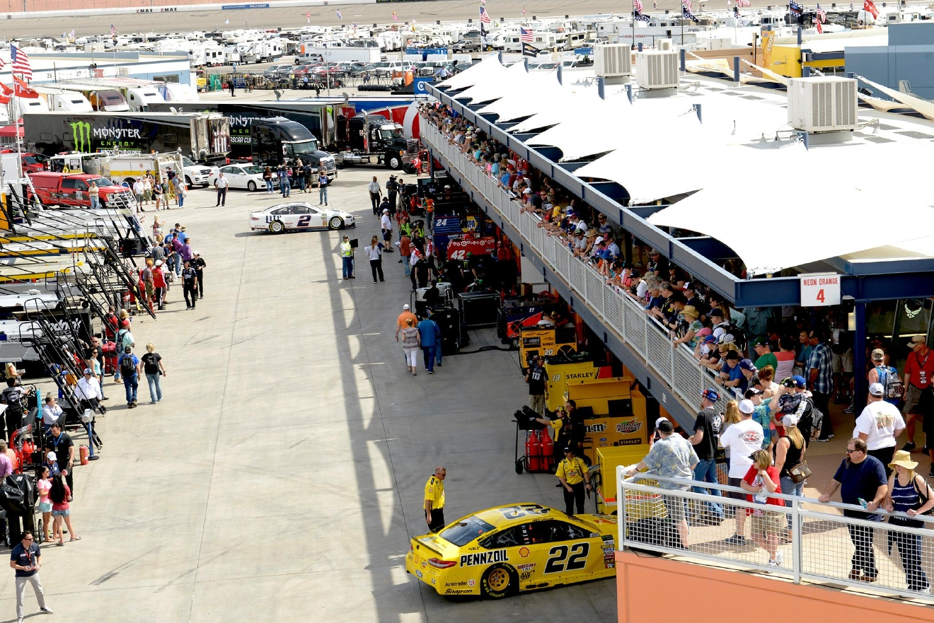 Fans crowd the rail above the NEON Garage as #2 Brad Keselowski (top) and #22 Joey Logano return from the track during NASCAR Stratosphere Pole Day at Las Vegas Motor Speedway. Friday, March 10, 2017. (Glenn Pinkerton/Las Vegas News Bureau)