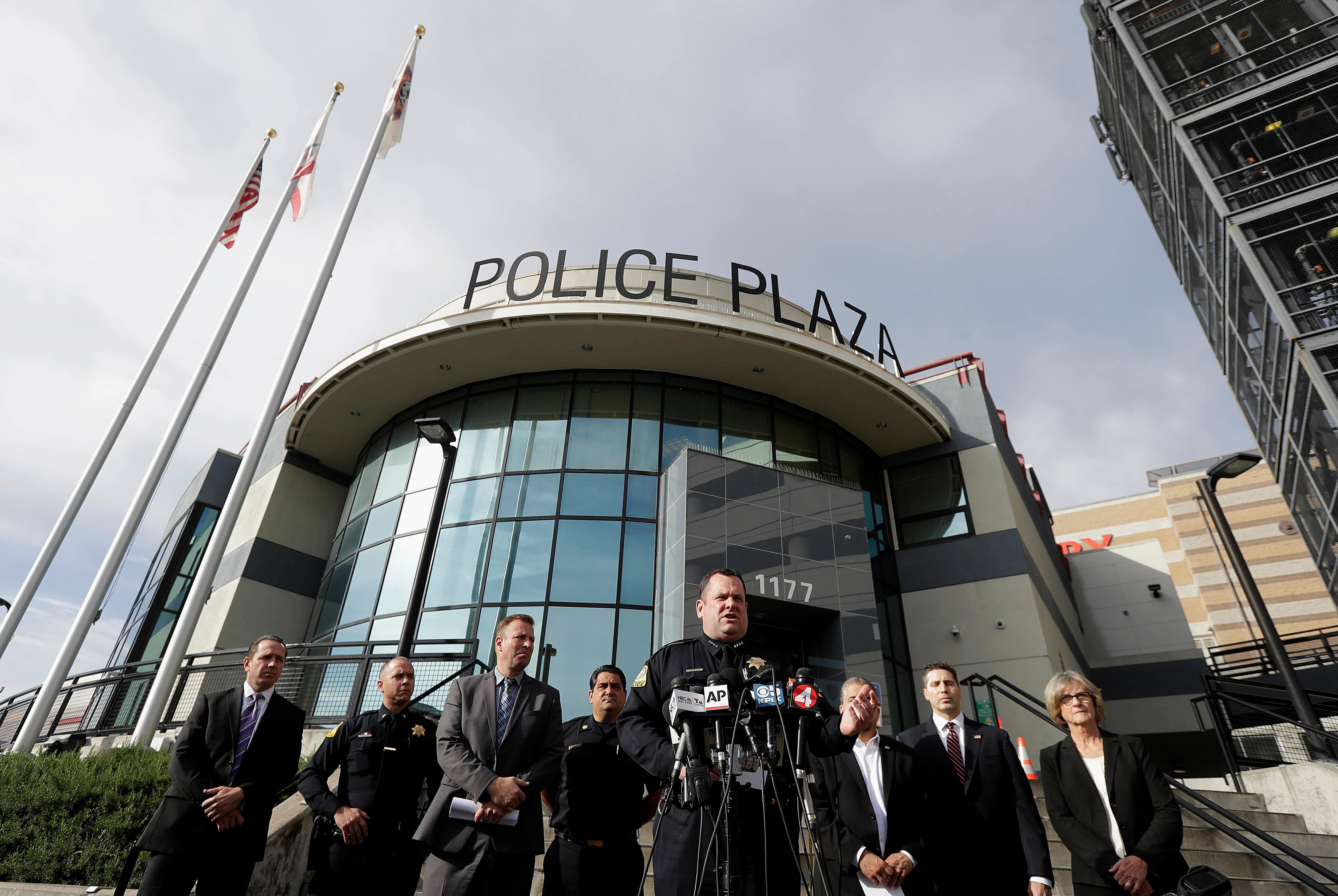 San Bruno Police Chief Ed Barberini, center, speaks at a news conference in San Bruno, Calif., Wednesday, April 4, 2018. A woman suspected of shooting three people at YouTube headquarters before killing herself was furious with the company because it had stopped paying her for videos she posted on the platform, her father said Tuesday, April 3, 2018. (AP Photo/Jeff Chiu)