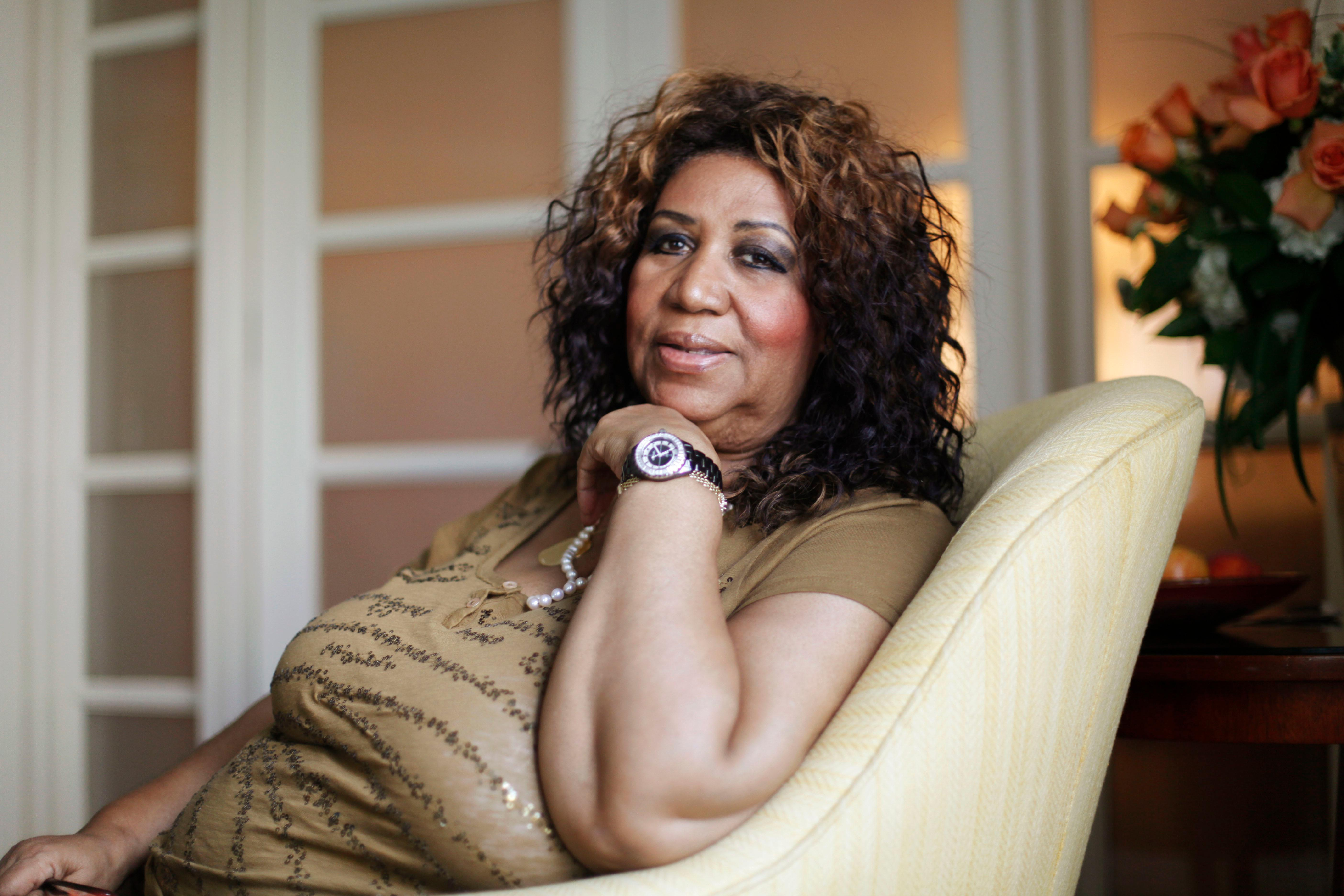 FILE - In this July 26, 2010 file photo, soul singer Aretha Franklin poses for a portrait in Philadelphia. Franklin died Thursday, Aug. 16, 2018 at her home in Detroit.  She was 76. (AP Photo/Matt Rourke, File)