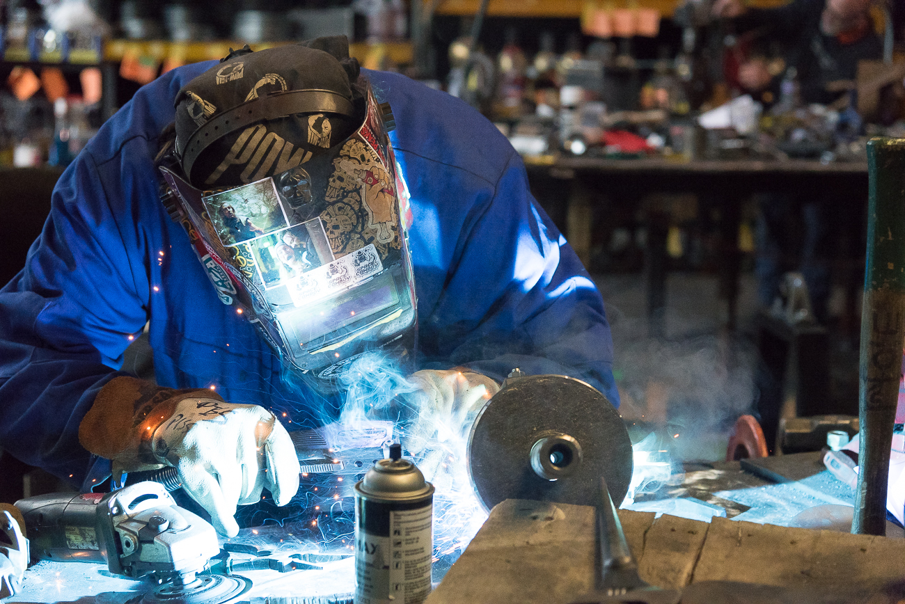 Verdin workers work to repair old, damaged bells using welding tools. / Image: Phil Armstrong, Cincinnati Refined // Published: 10.19.18
