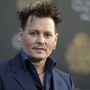 Johnny Depp apologizes for 'assassin' comments