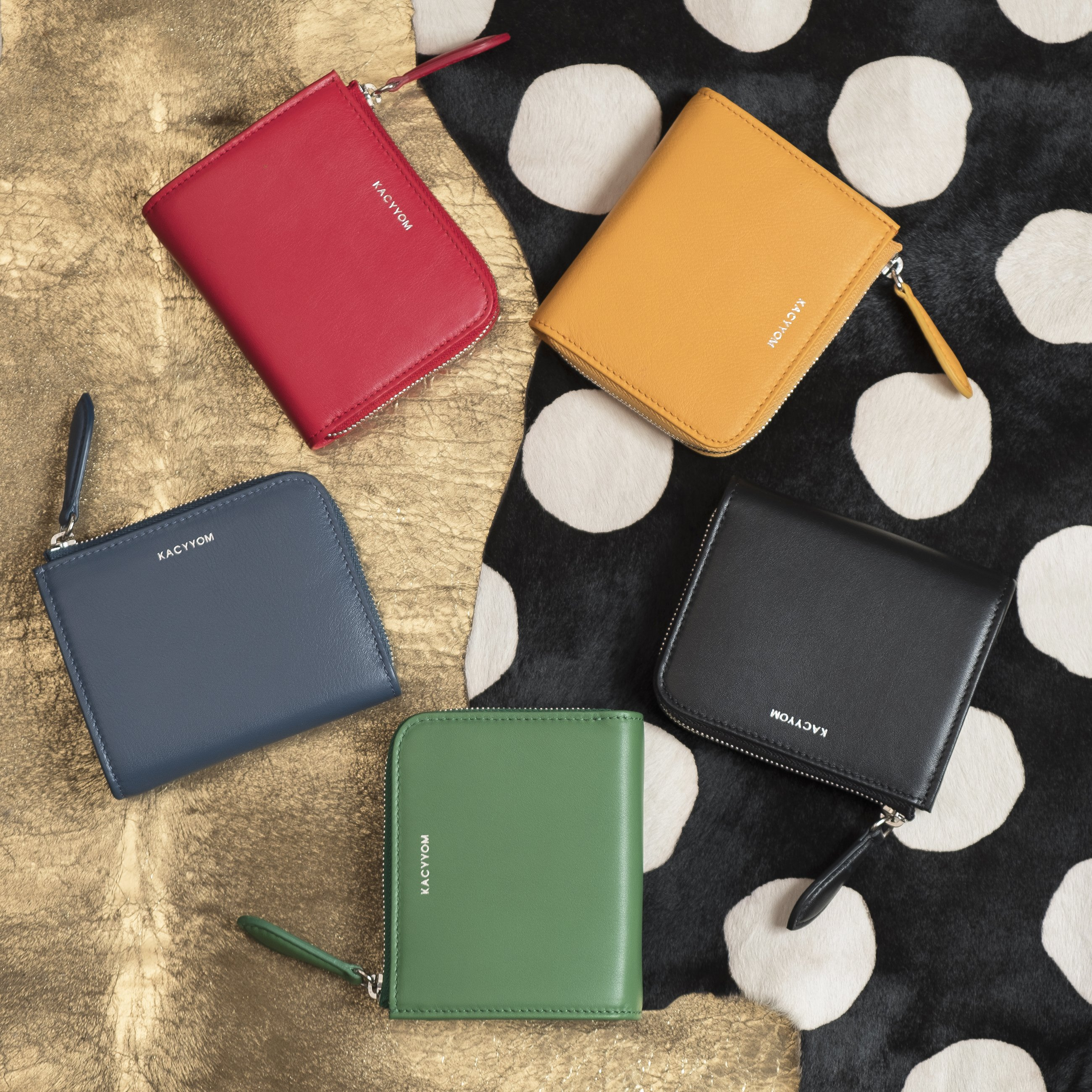 This $200 mini wallet from KacyYom comes in a handful of colors and is hand crafted with Italian classic leather.{&nbsp;} Perfect for the classy mom! Plus its a local brand.{&nbsp;} We love shopping local!{&nbsp;}<p></p>